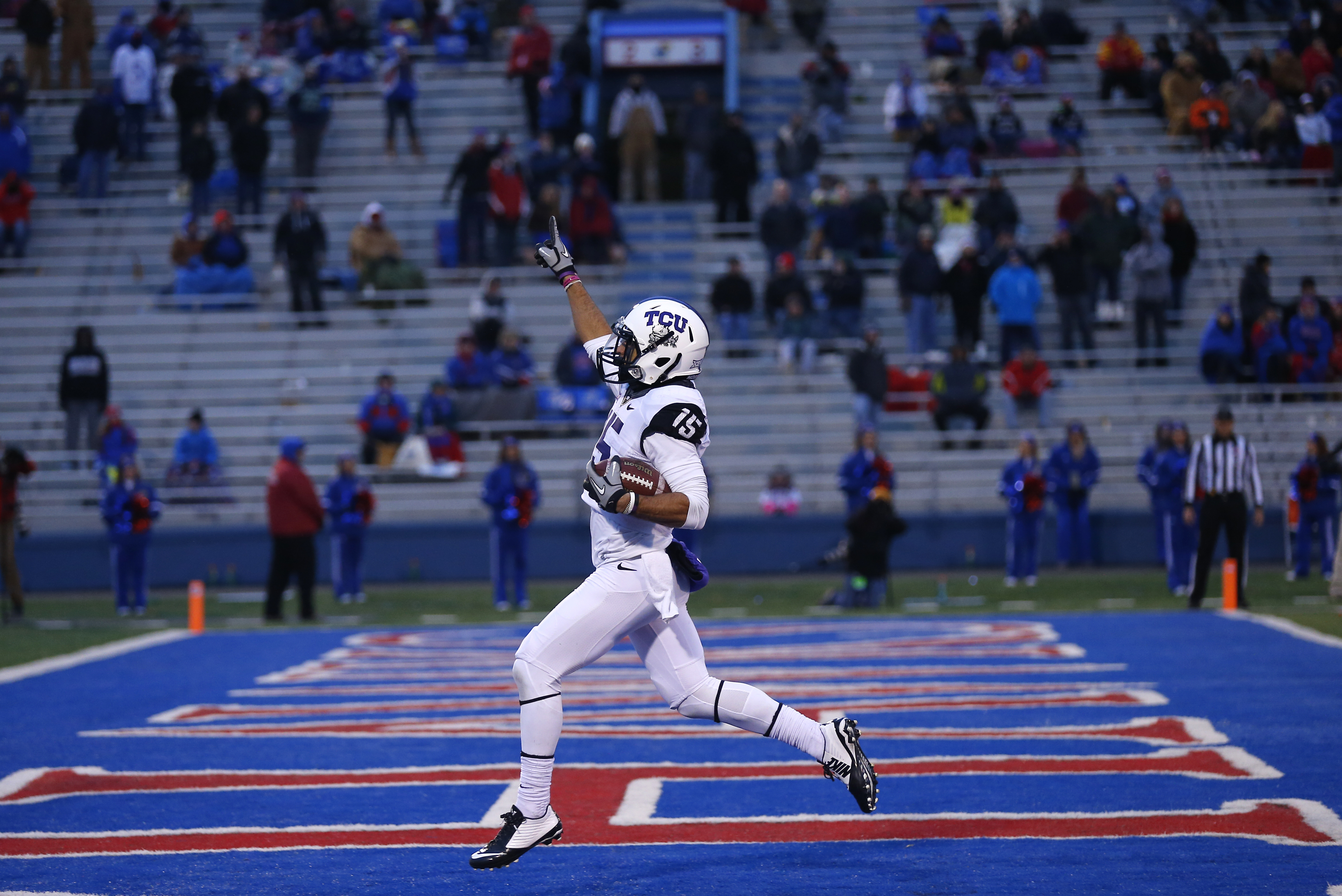 Cameron Echols-Luper of the TCU Horned Frogs celebrates his 69-yard punt return for a touchdown in the third quarter during a game against the Kansas Jayhawks at Memorial Stadium on Nov. 15, 2014 in Lawrence, Kansas.