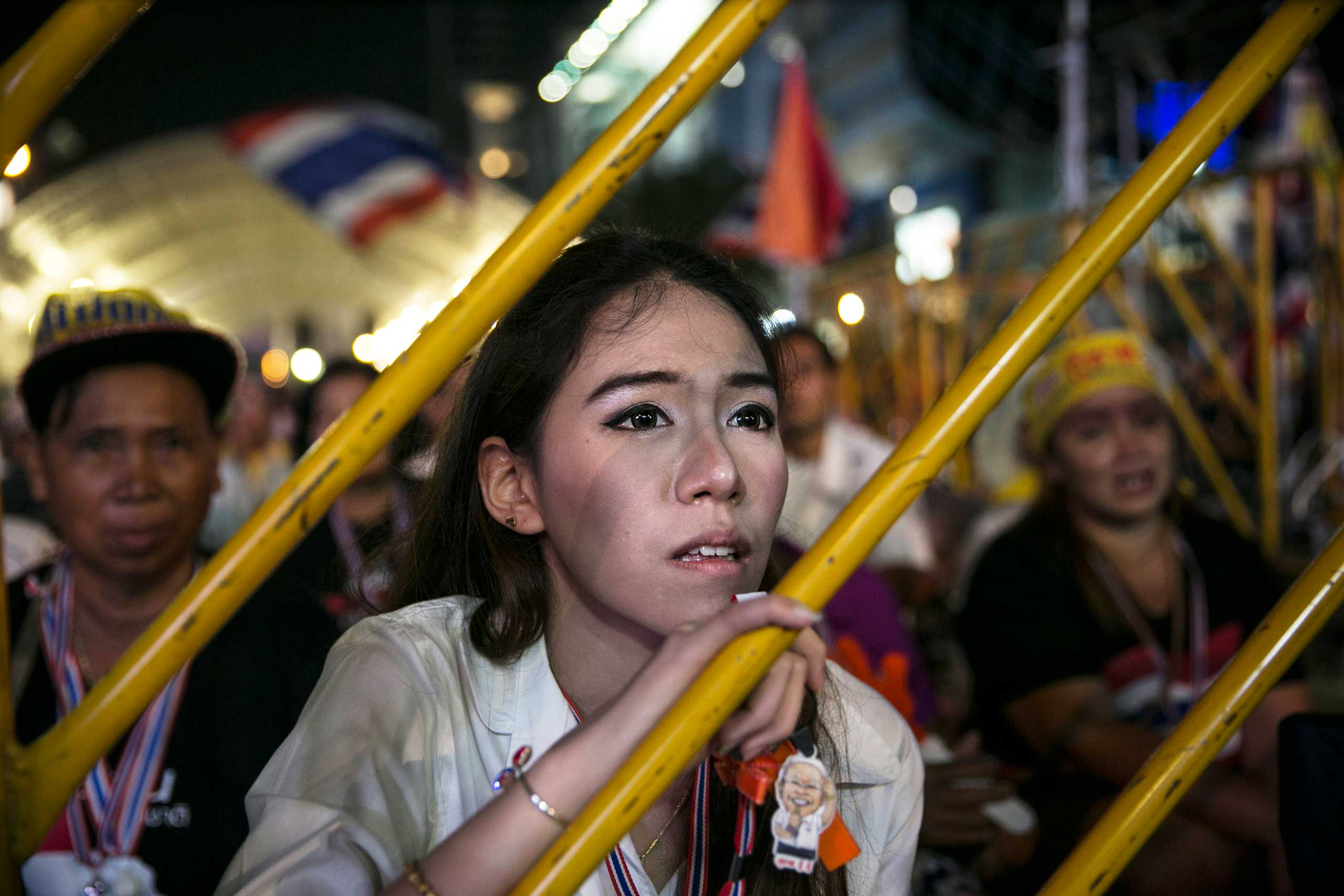 Thailand: Anti-government protestsAn anti-government protestor listens as leader Suthep Thaugsuban speaks about the elections during his daily speech Feb. 3, 2014 in Bangkok.