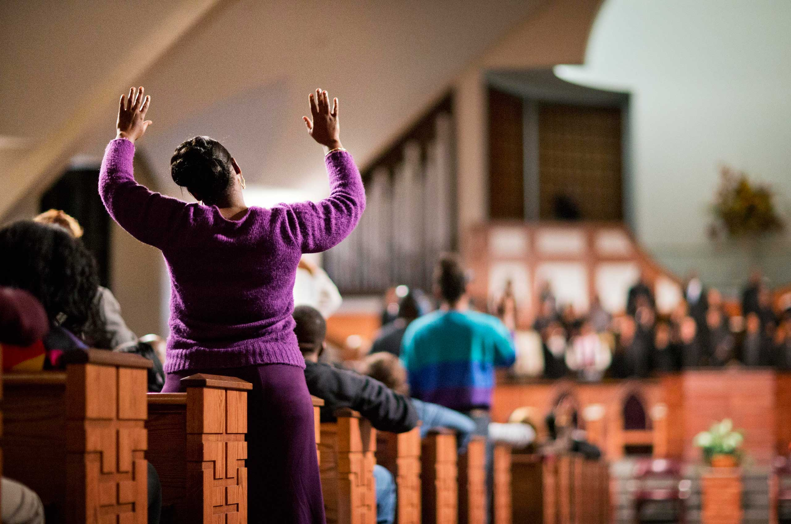 Dec. 1, 2014. A woman raises her hands as the choir sings before U.S. Attorney General Eric Holder speaks to the community during an interfaith service at Ebenezer Baptist Church in Atlanta, where Martin Luther King Jr. preached.