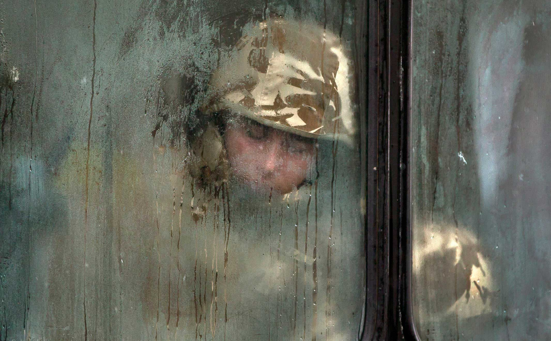 Dec. 1, 2014. A Romanian soldier sleeps on a bus before taking part in a military parade to mark Romania's national day in Bucharest, Romania.