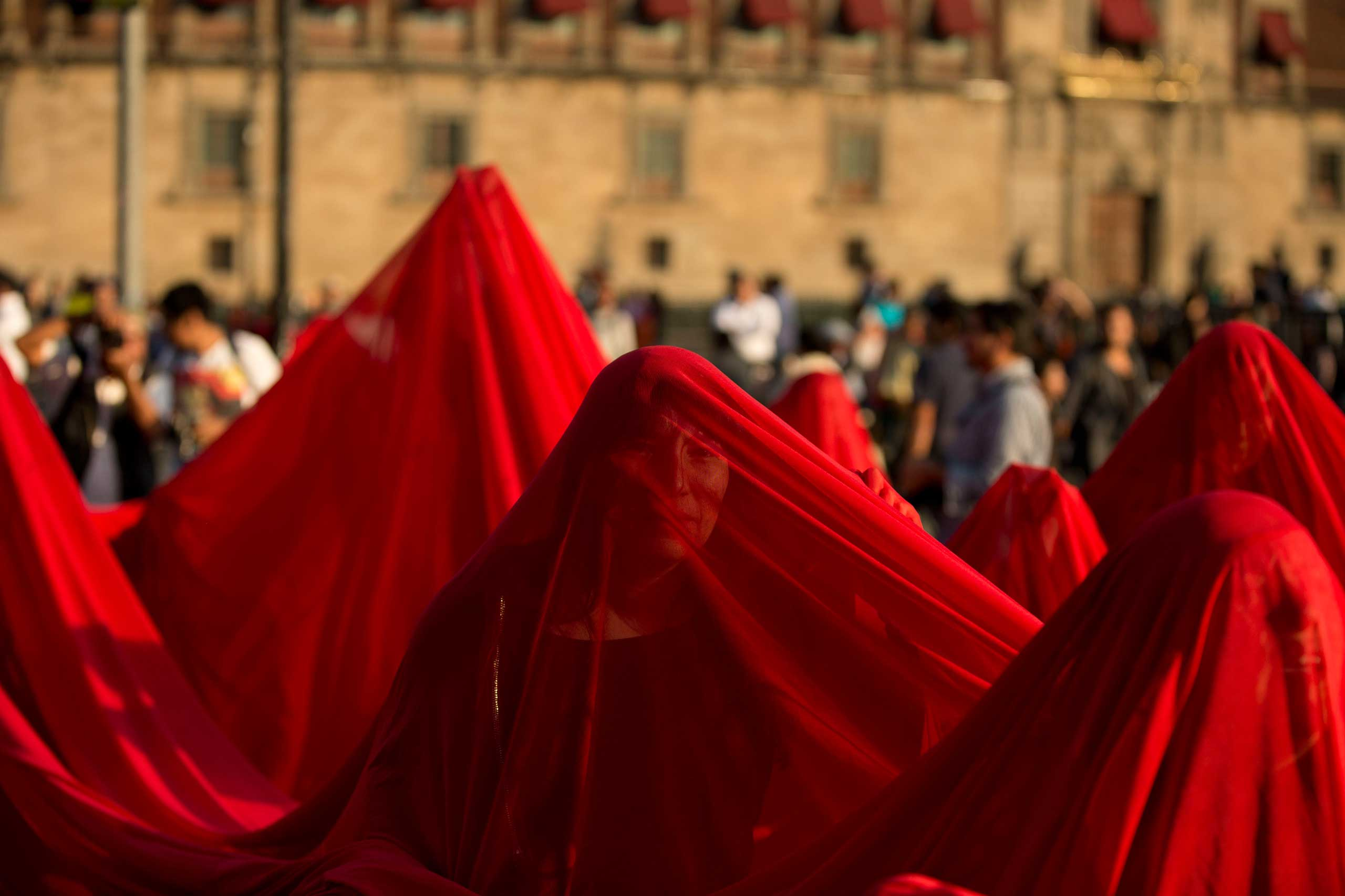 Dec. 1, 2014. Protestors draped in a giant red cloth to represent blood march during a demonstration in Mexico City, marking the second anniversary of President Enrique Pena Nieto's administration and demanding the government to find 43 students who disappeared at the hands of police.