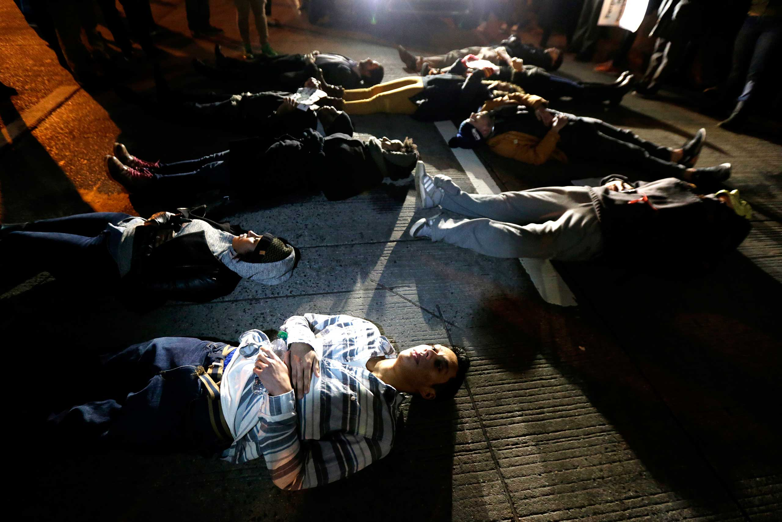 Dec. 3, 2014. People lie on the middle of the West Side Highway in New York during a protest after it was announced that the New York City police officer involved in the death of Eric Garner was not indicted. A grand jury cleared the officer in the videotaped chokehold death of Garner, an unarmed black man, who had been stopped on suspicion of selling loose, untaxed cigarettes.