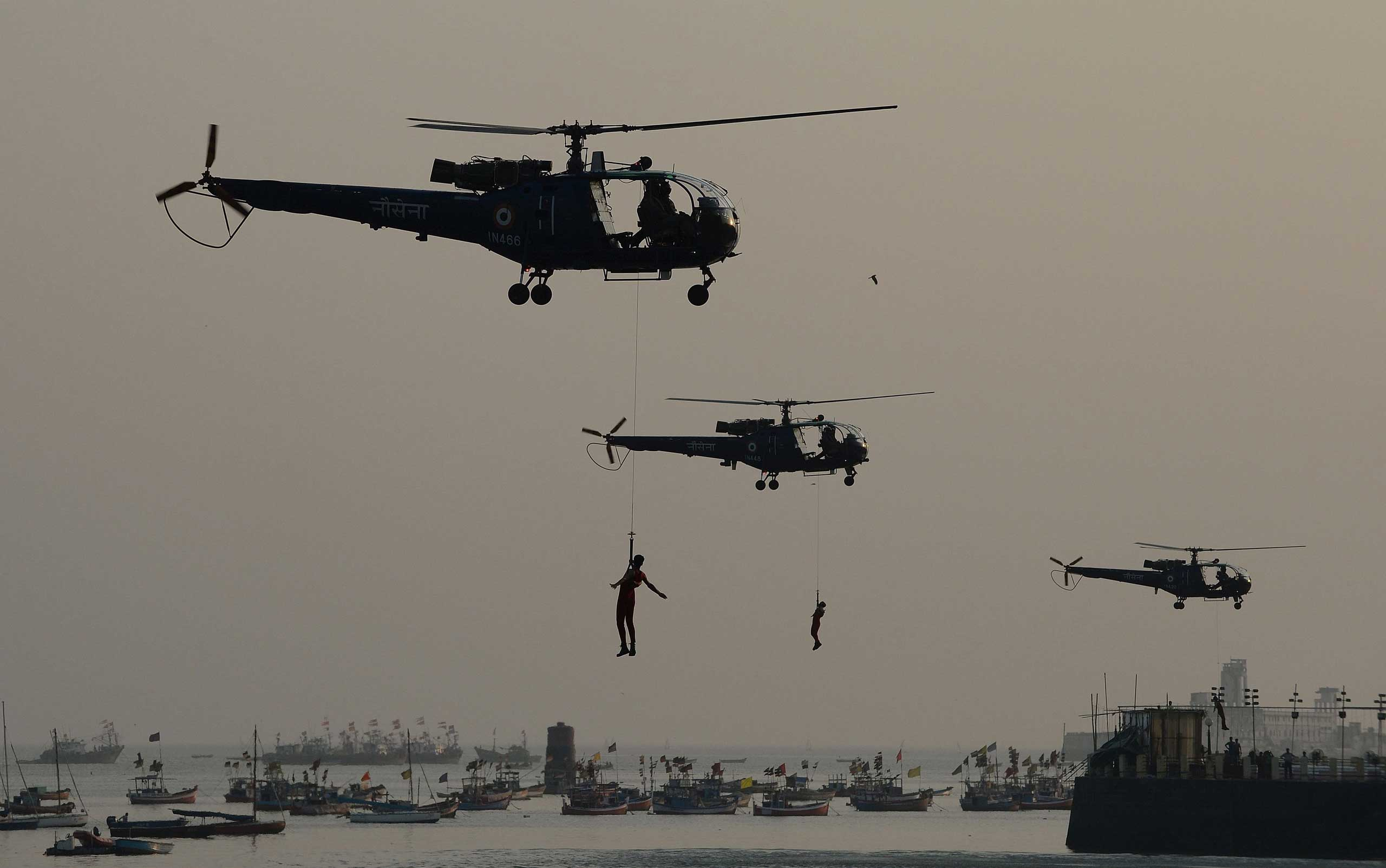 Dec. 2, 2014. Indian navy sailors take part in a rescue demonstration during a rehearsal for the forthcoming Navy Day celebrations in front of the Gateway of India in Mumbai as a tribute to the maritime operations of the Indian Navy during the 1971 Indo-Pakistan war.