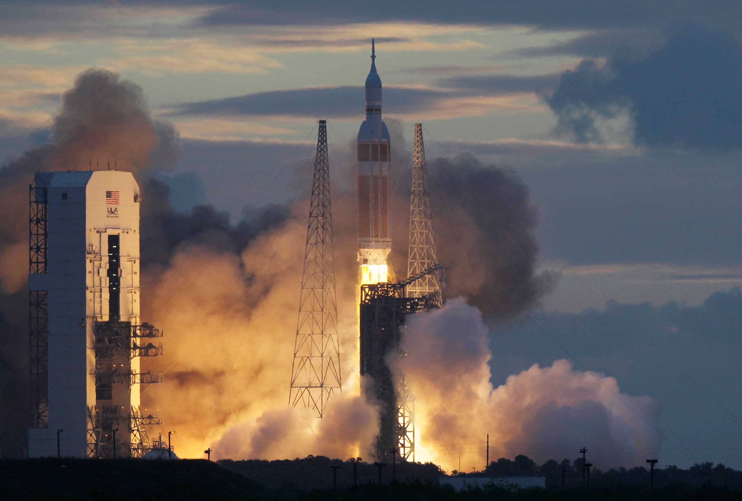Dec. 5, 2014. A NASA Orion capsule on top of a Delta rocket lifts off on its first unmanned orbital test flight from Complex 37 B at the Cape Canaveral Air Force Station at Cape Canaveral, Fla.