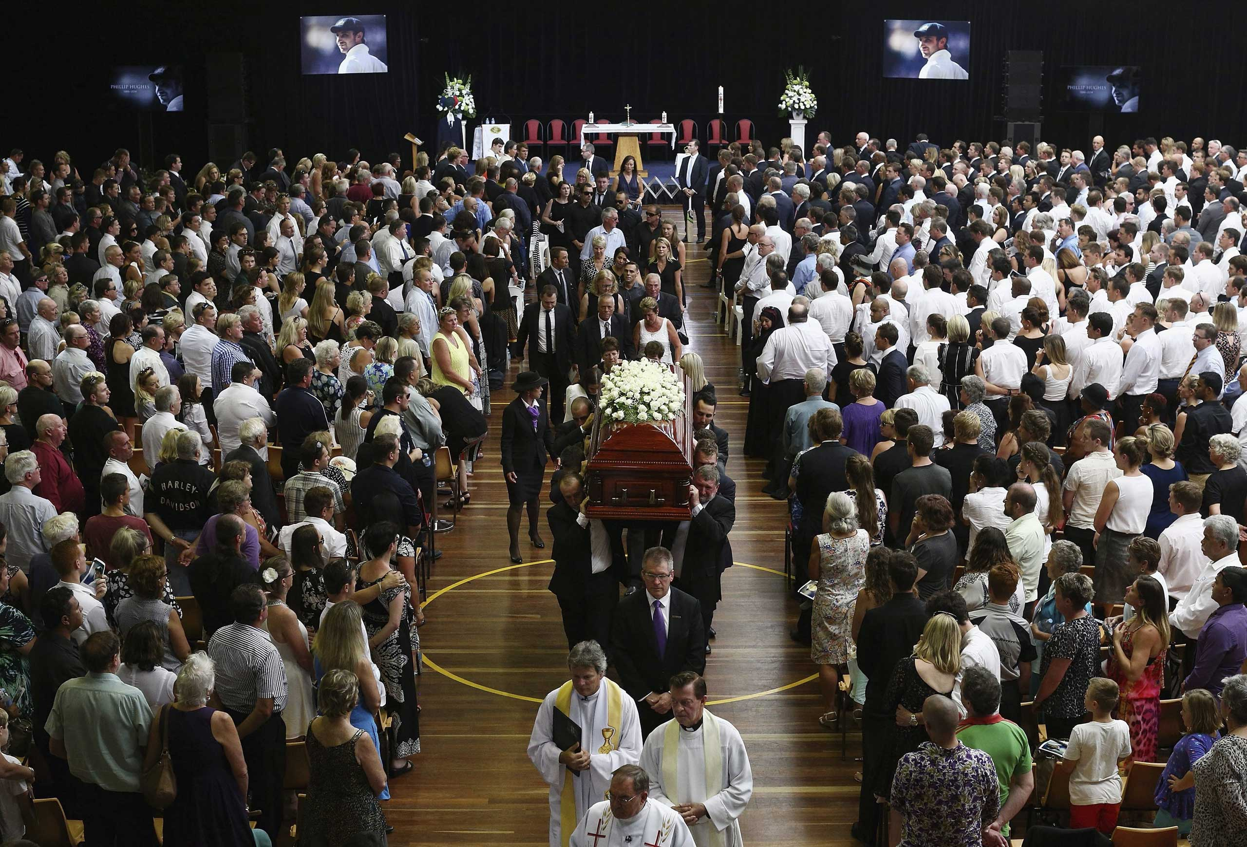 Dec. 3, 2014. The coffin of Australian cricketer Phillip Hughes is carried down the aisle during his Funeral Service in Macksville, Australia. Hughes, 25 died on after he was hit by a cricket ball while batting for South Australia during a Sheffield Shield game against New South Wales at the Sydney Cricket Ground.