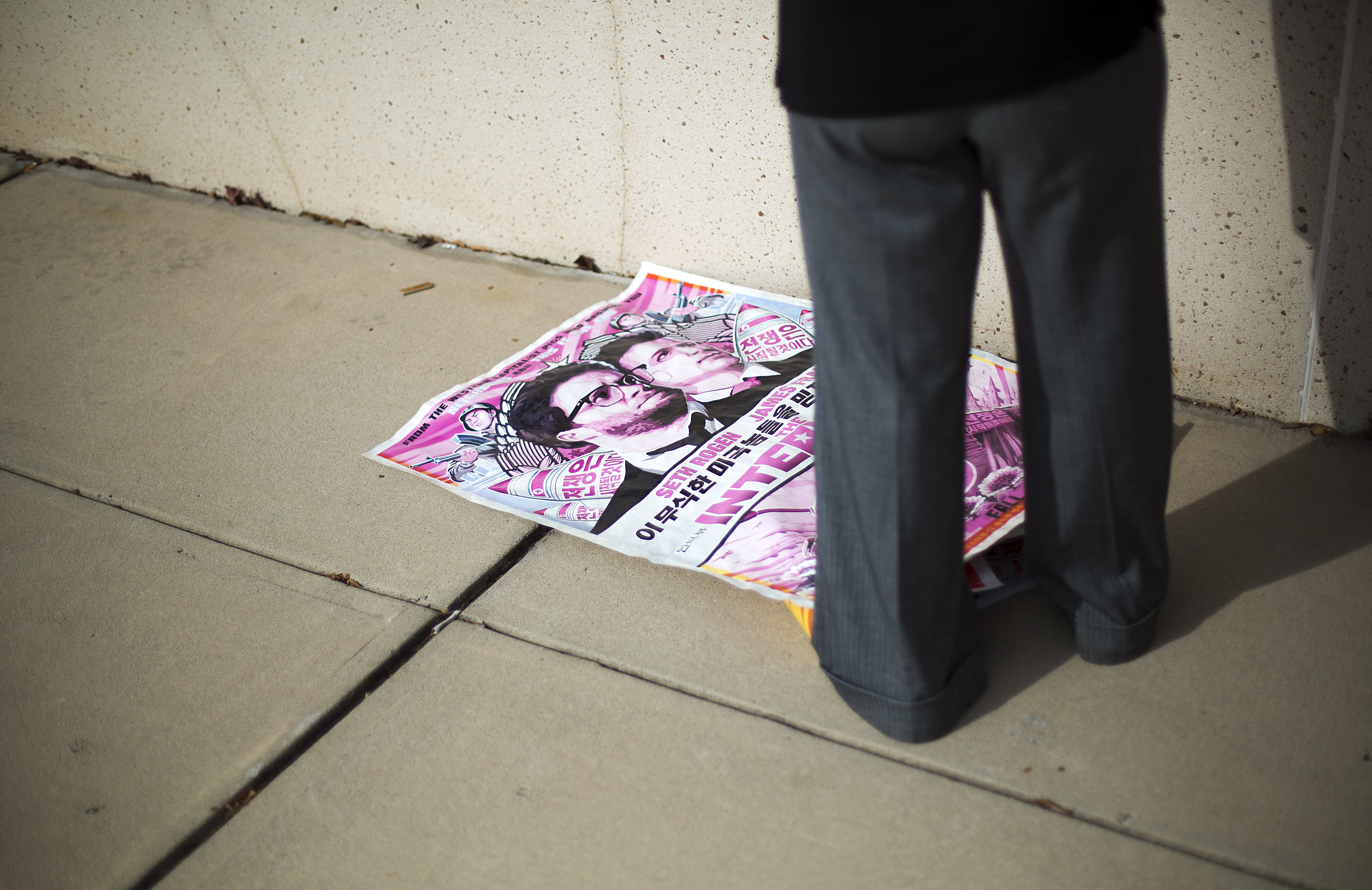 A poster for the movie  The Interview  lays on the ground after being pulled from a display case by a worker at a Carmike Cinemas movie theater on Dec. 17, 2014, in Atlanta.