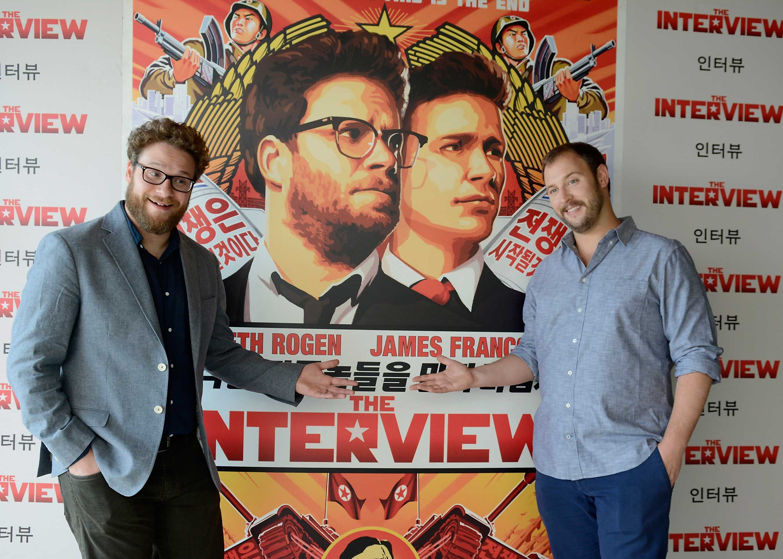 Seth Rogen (L) and Evan Goldberg pose during a photocall for their latest film 'The Interview' at the Hotel Mandarin on June 18, 2014