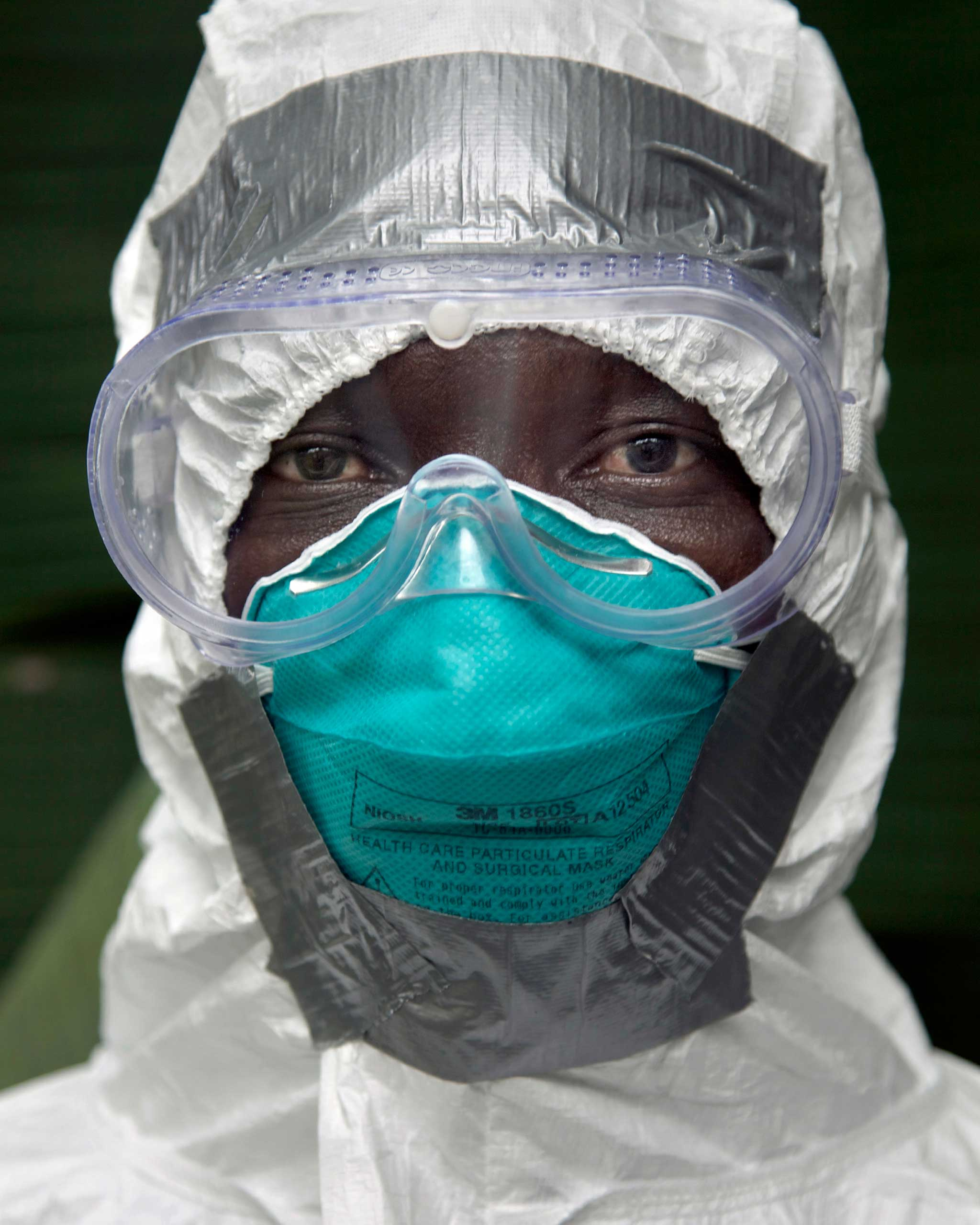 Foday Galla, 37, Ambulance Supervisor, photographed at home wearing a PPE (Personal Protective Equipment) suit, in Signboard community, in Monrovia, Liberia. Nov. 26, 2014