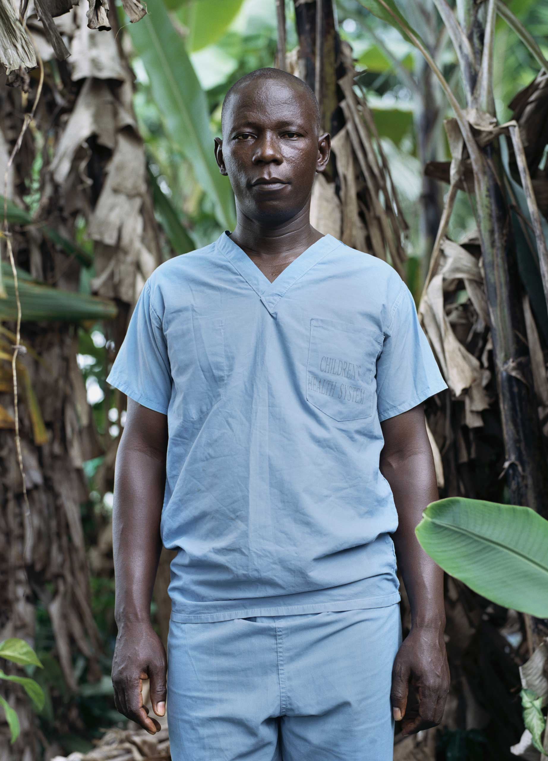 Foday Galla, 37, Ambulance Supervisor, photographed in Signboard community, in Monrovia, Liberia. Nov. 26, 2014