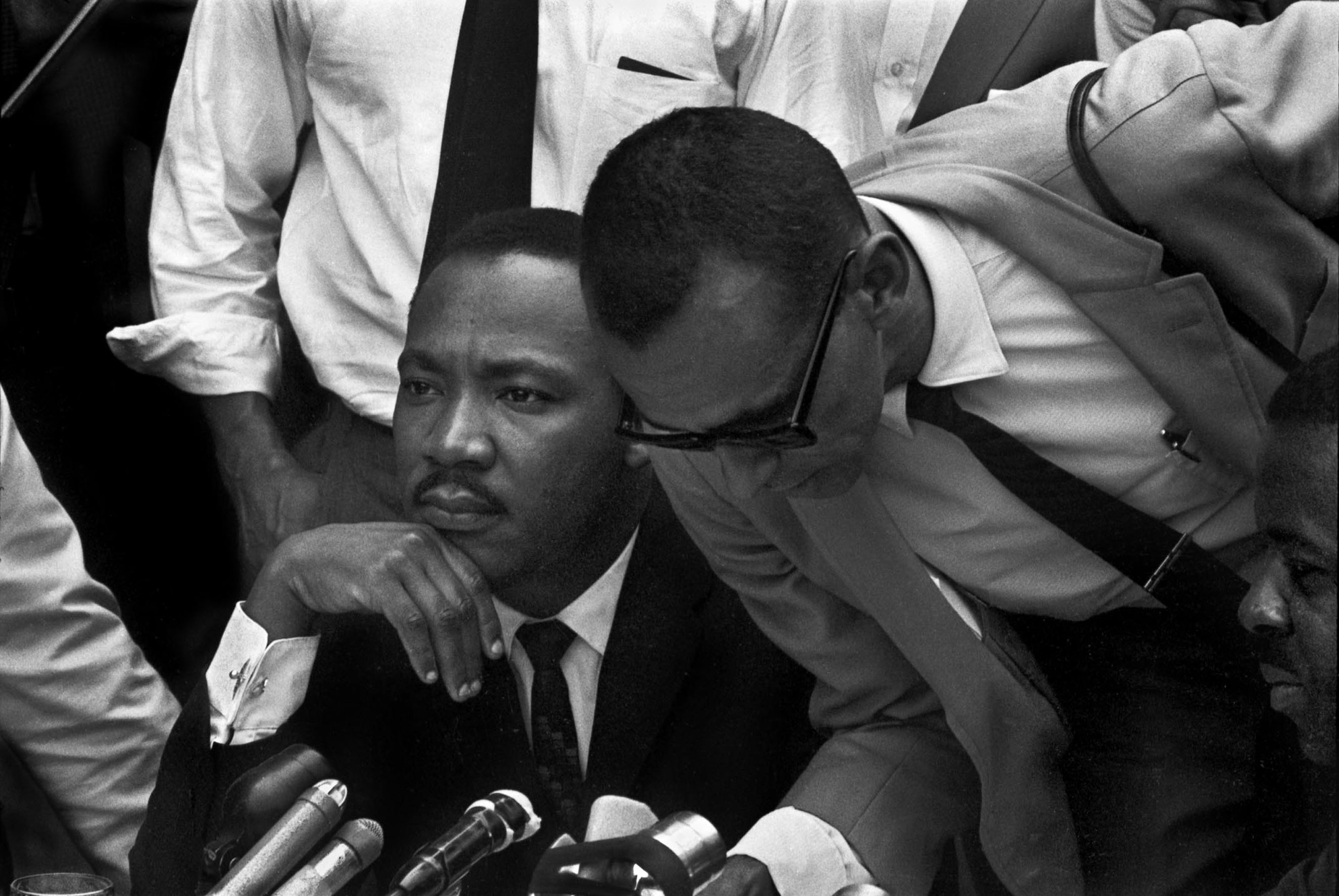From left: Dr. Martin Luther King and Rev. Wyatt Tee Walker announce an agreement with Birmingham, Ala., businesses to desegregate certain sevices and jobs in the city.