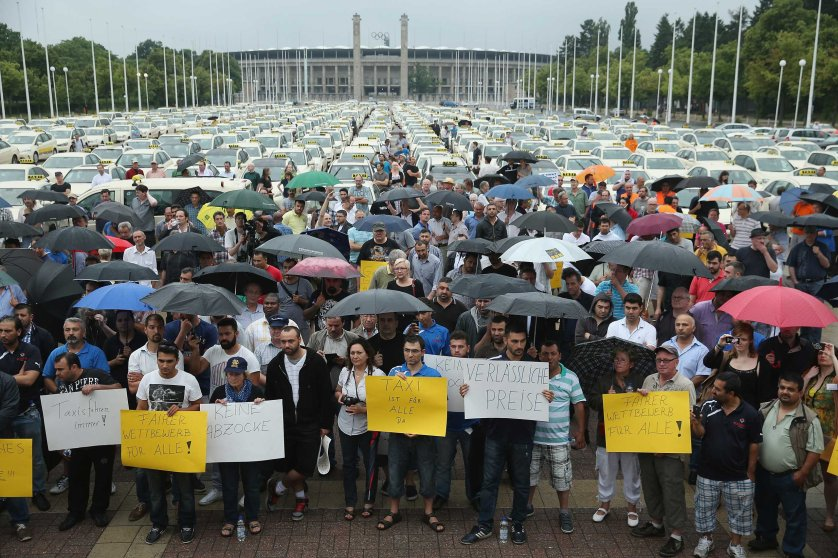 Hundreds of taxi drivers gather next to the Olympia Stadium to protest ride-sharing apps on June 11, 2014 in Berlin.