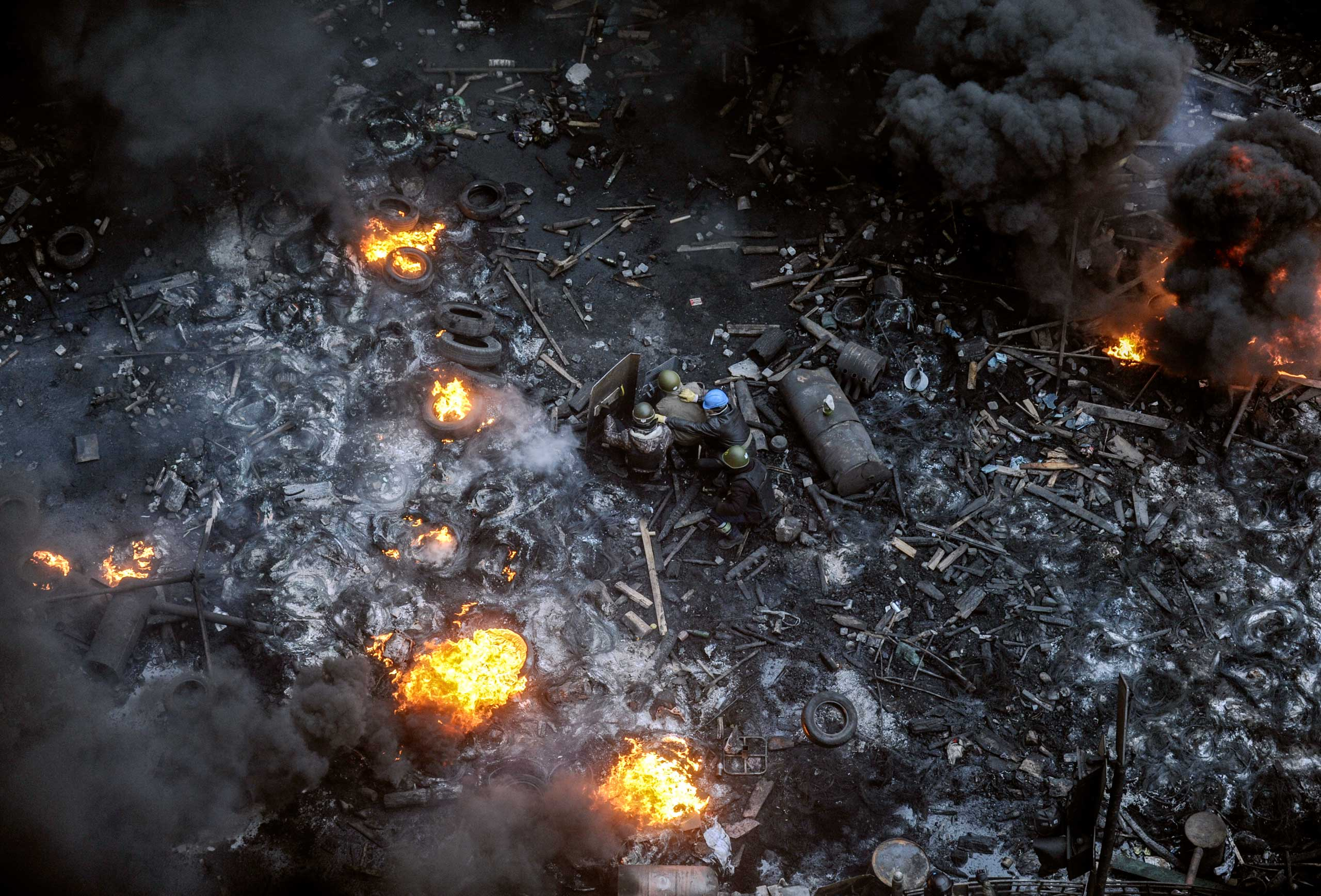 Ukraine: Euromaidan protestsProtesters stand behind burning barricades during a face-off against police on Feb. 20, 2014 on Independence Square in Kiev.