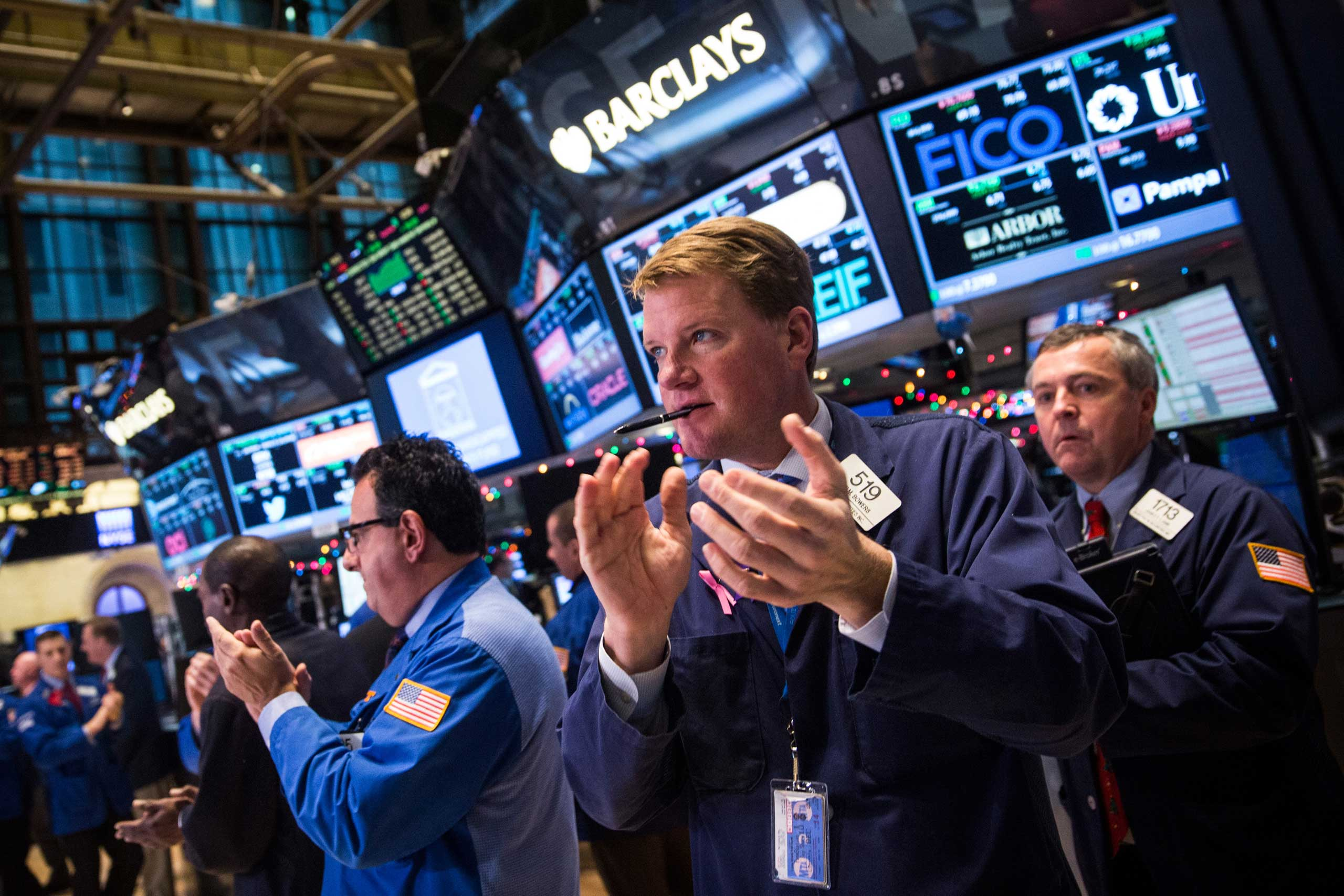 Traders work on the floor of the New York Stock Exchange in Nwe York City on Dec. 18, 2014.