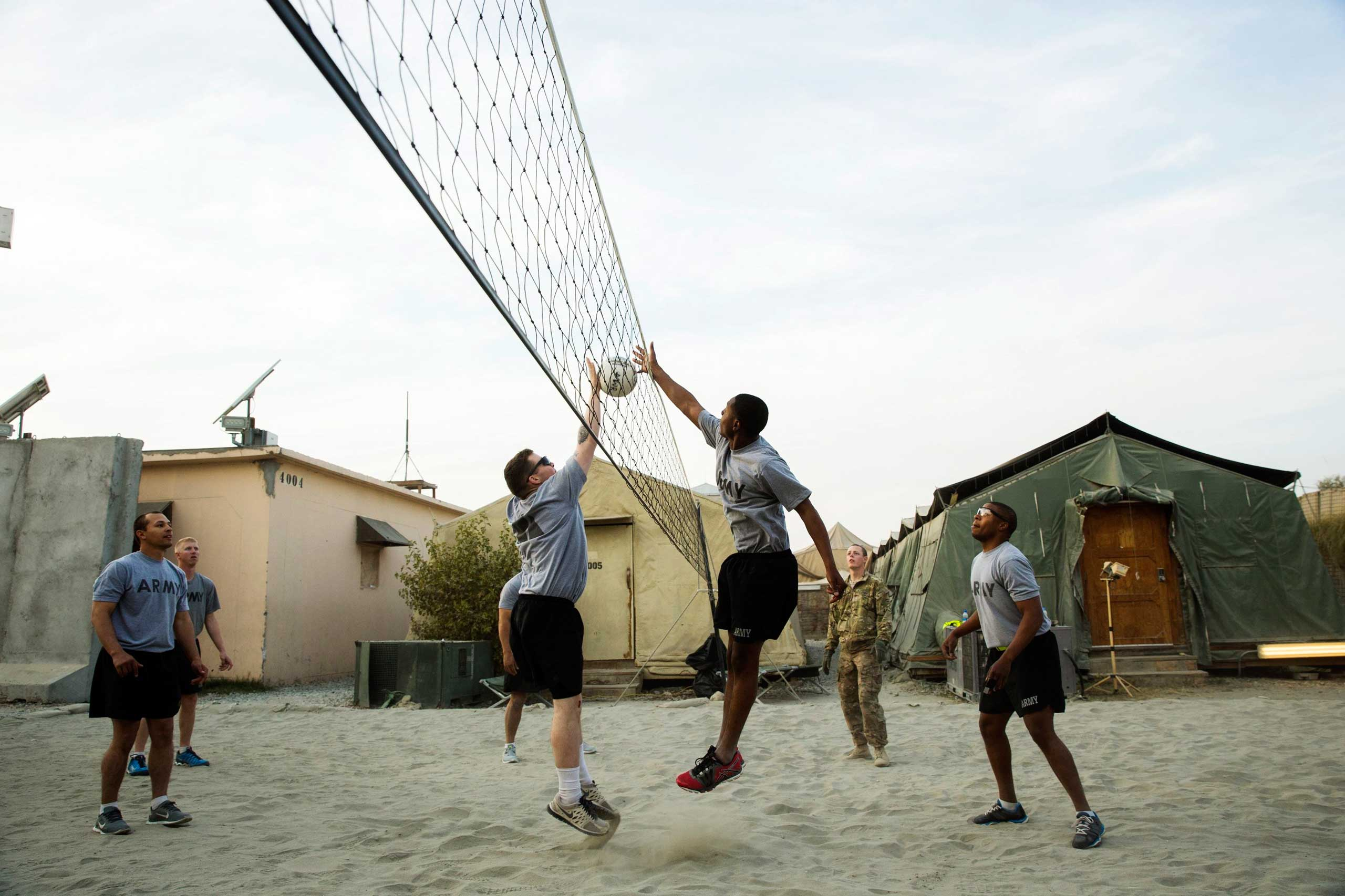 U.S. soldiers play volleyball at forward operating base Fenty in the Nangarhar province of Afghanistan on Dec. 21, 2014.