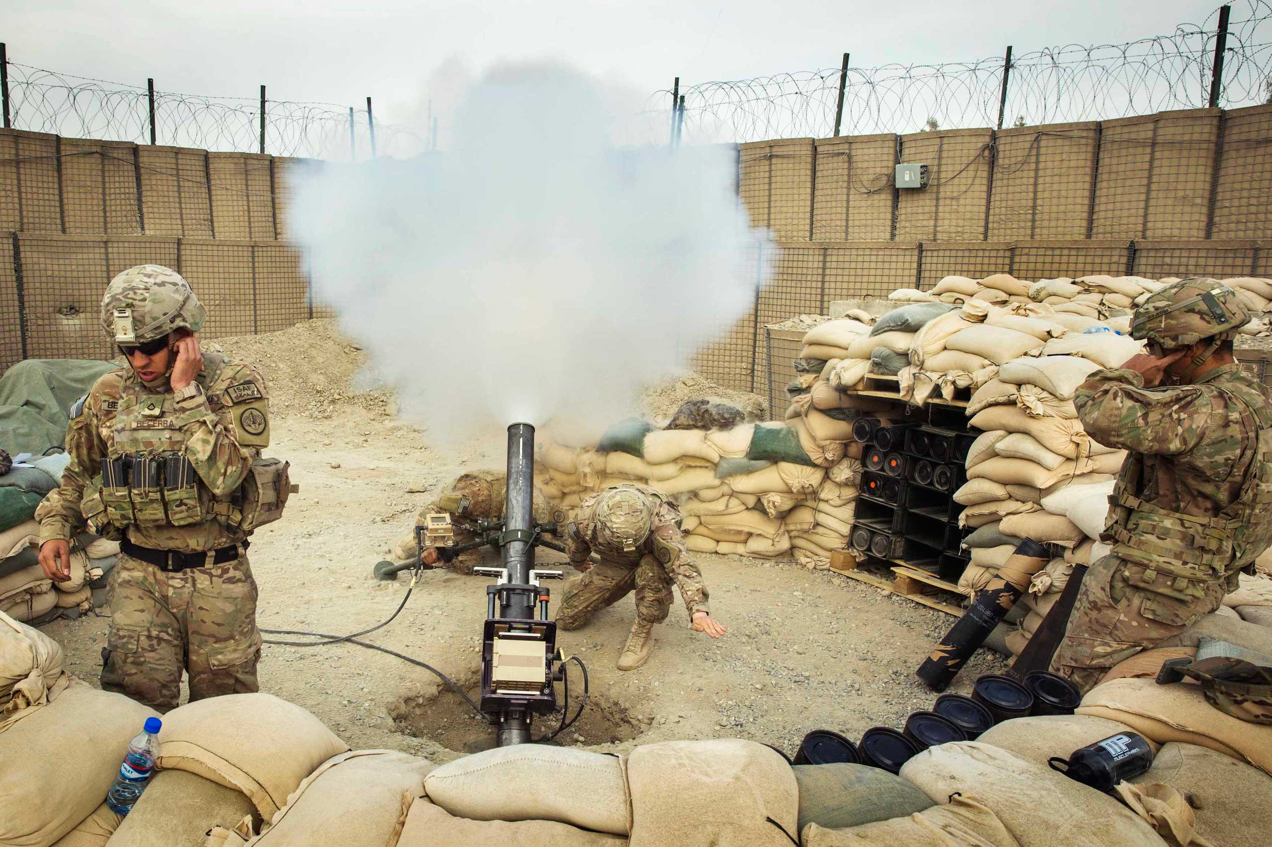 U.S. soldiers from the 3rd Cavalry Regiment fire a 120mm mortar during an exercise on forward operating base Gamberi in the Laghman province of Afghanistan on Dec. 24, 2014.