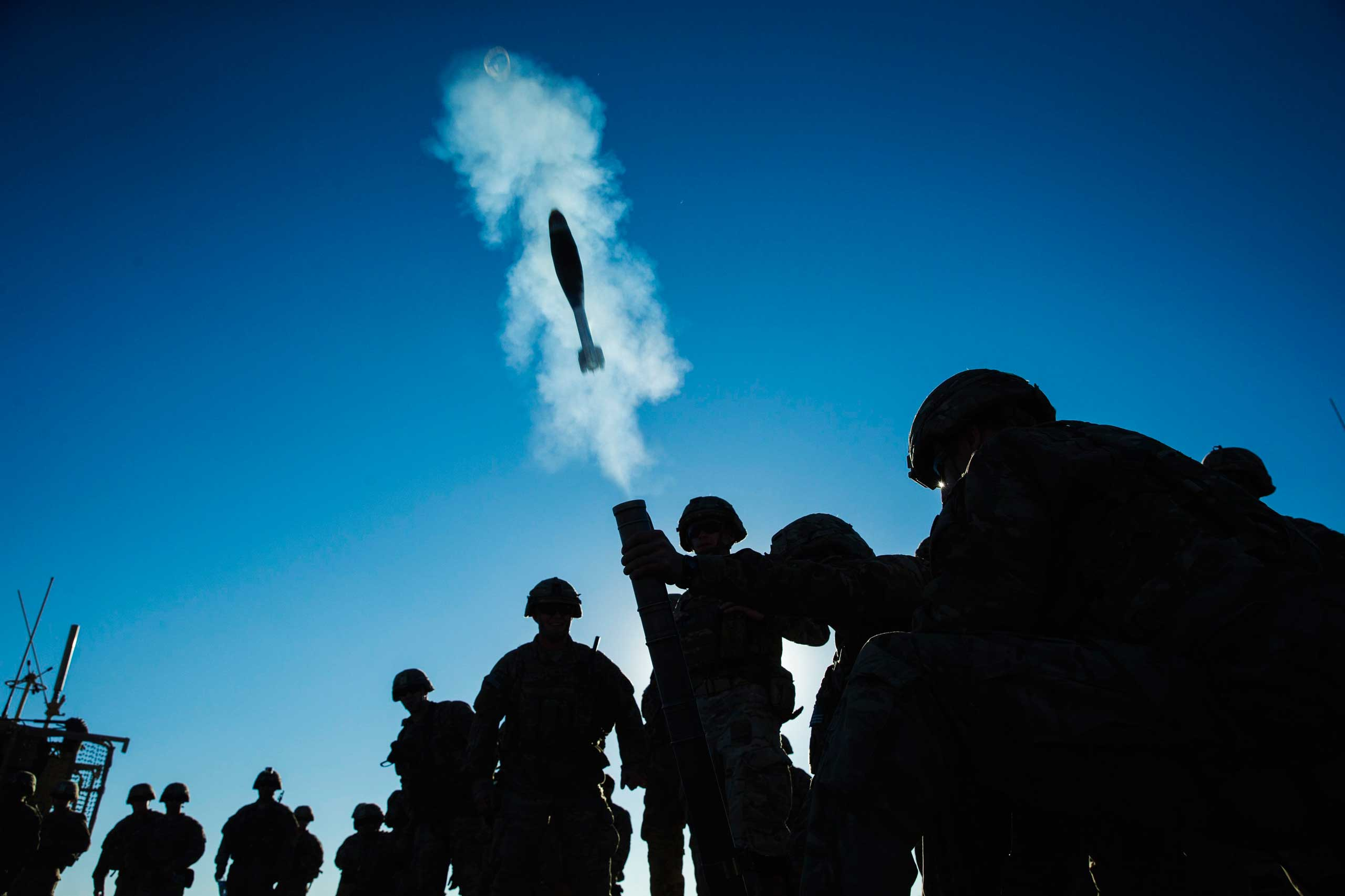A mortar flies out of a tube during a mortar exercise for U.S. soldiers in Dragon Company of the 3rd Cavalry Regiment near forward operating base Gamberi in the Laghman province of Afghanistan on Dec. 26, 2014.