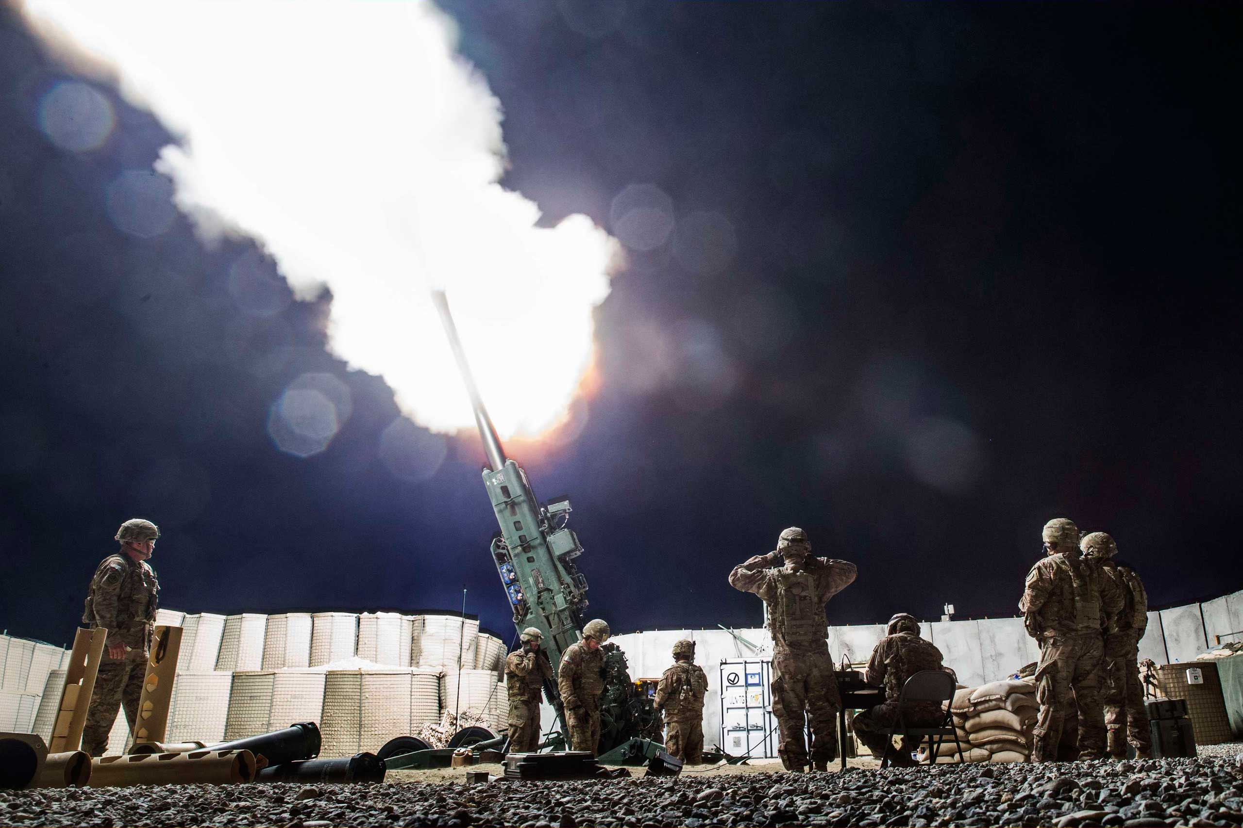 U.S. soldiers from the 3rd Cavalry Regiment take part in an artillery exercise on forward operating base Gamberi in the Laghman province of Afghanistan on Dec. 24, 2014.
