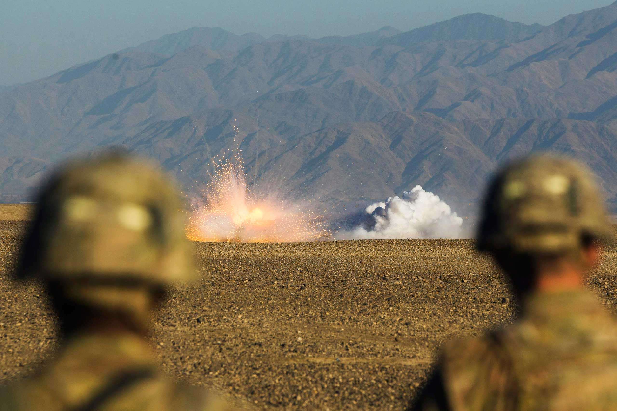 U.S. soldiers in Dragon Company of the 3rd Cavalry Regiment watch rounds explode downrange during a mortar exercise near forward operating base Gamberi in the Laghman province of Afghanistan on Dec. 26, 2014.