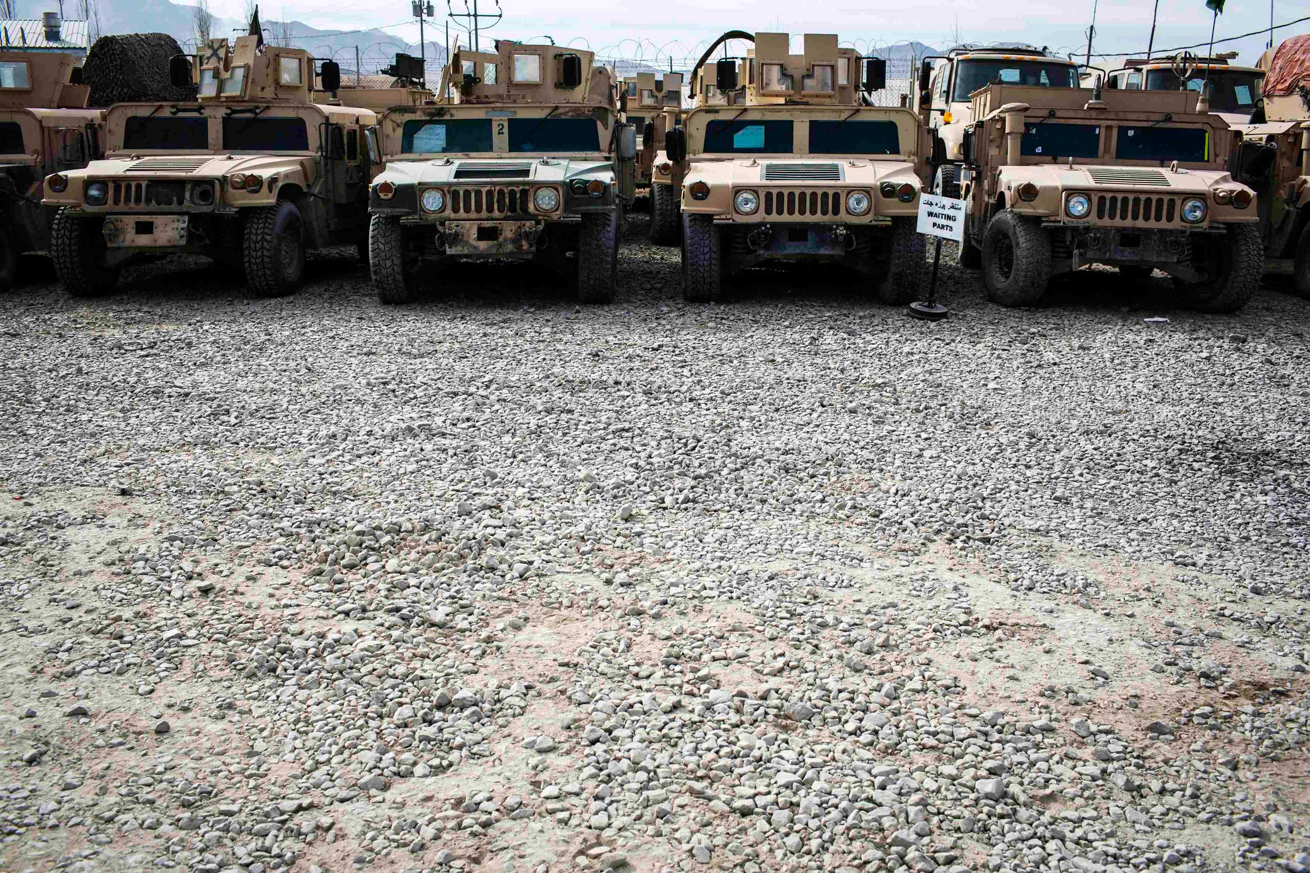 Humvees for the Afghan National Army are lined up waiting for repair parts at the Afghan National Army headquarters for the 203rd Corps in the Paktia province of Afghanistan on Dec. 21, 2014.