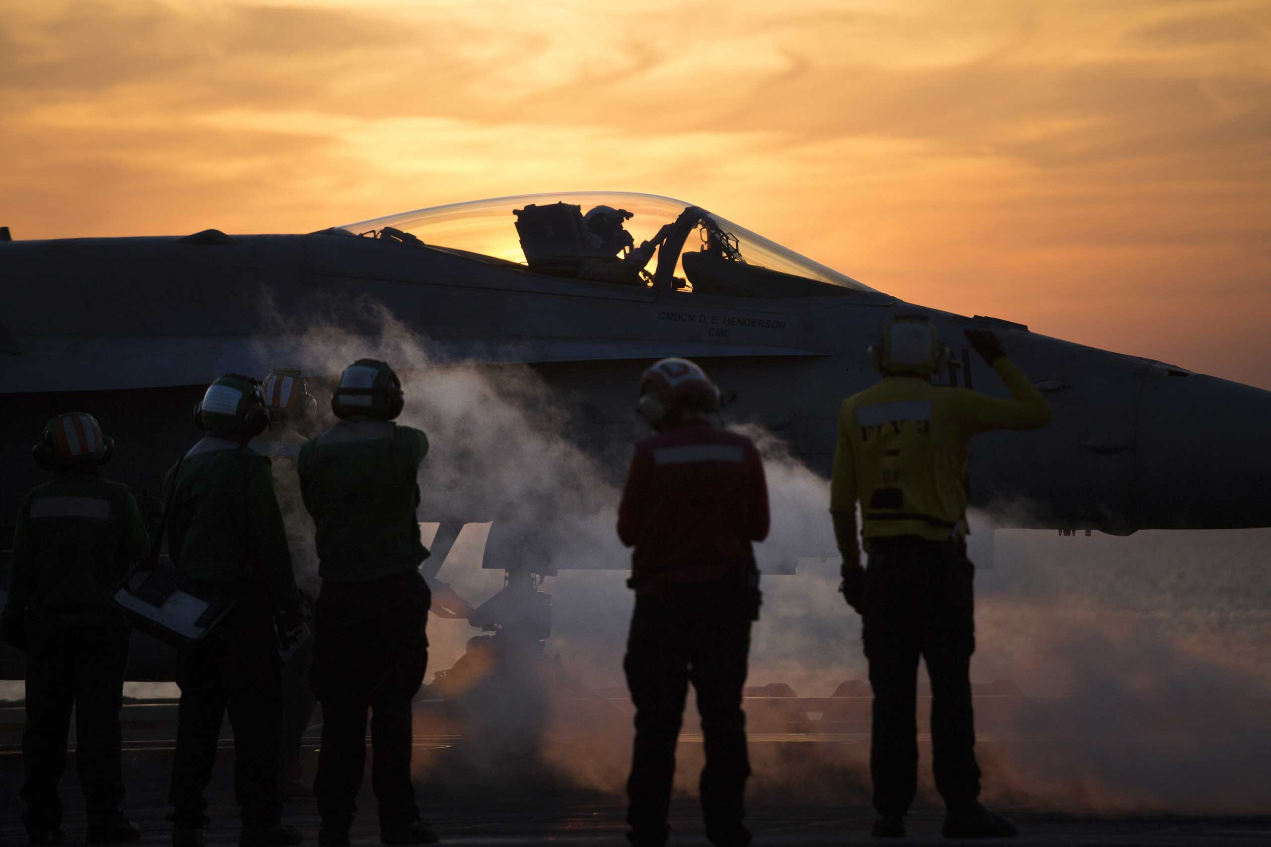 The New York Times: A Desert War on ISIS, Fought From a Floating CityCrew members around an aircraft aboard the USS Carl Vinson, a Nimitz-class aircraft carrier, in the Persian Gulf, Dec. 8, 2014.