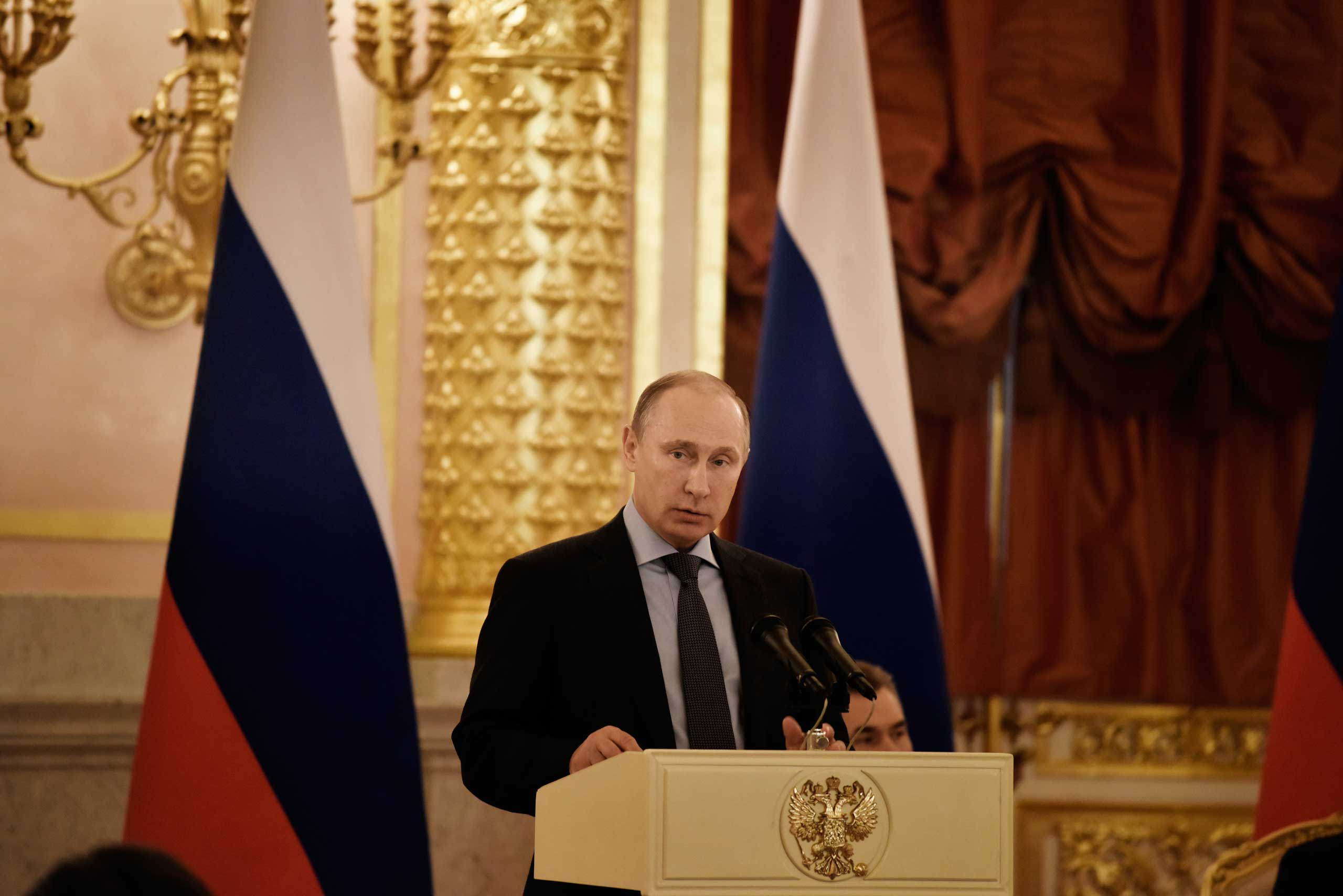 President Vladimir Putin speaks during his meeting with Human Rights activists in the Grand Kremlin Palace, Moscow, Dec. 5, 2014.