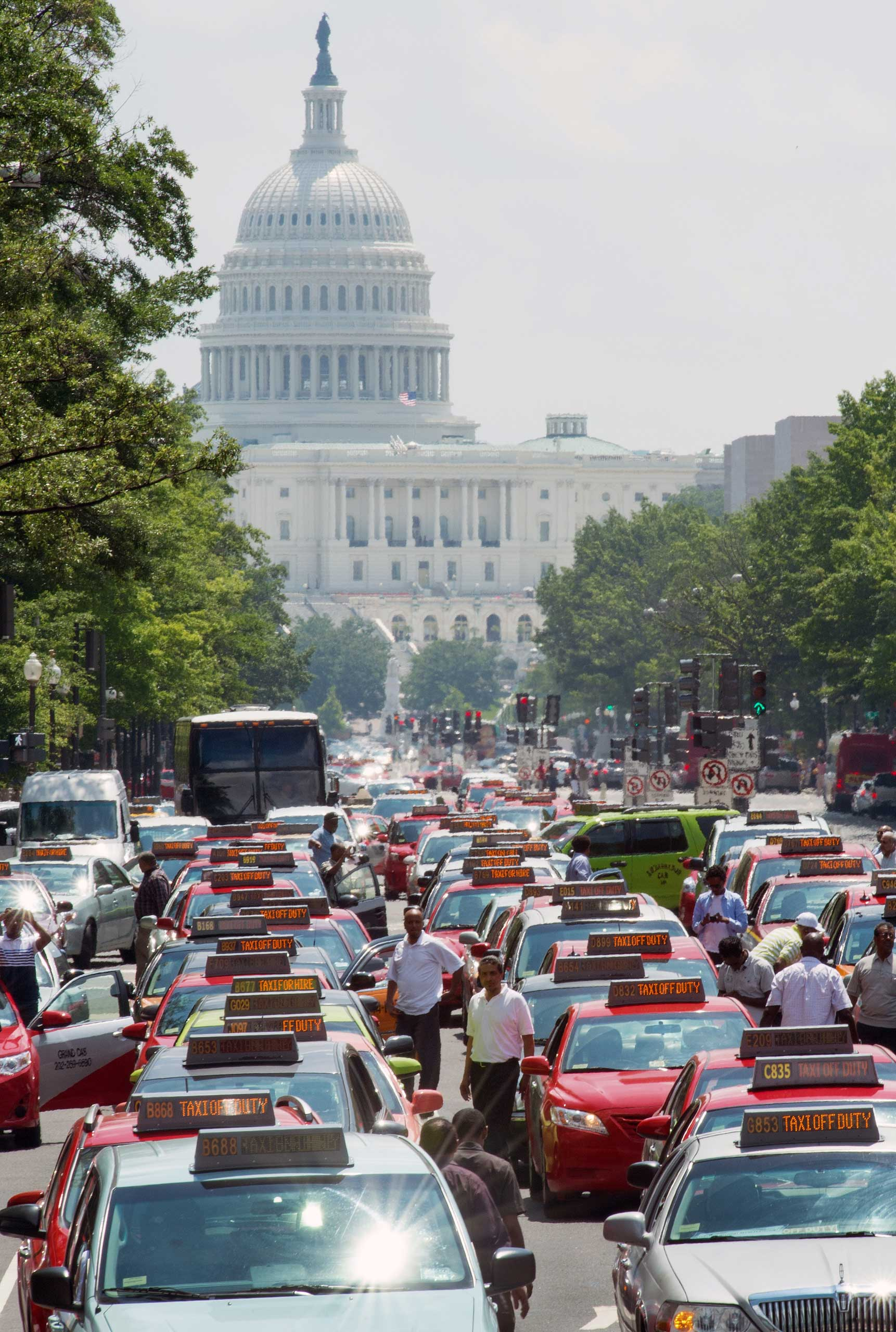 Taxi drivers park their cars and honk the horn in protest on Pennsylvania Avenue, bringing street traffic to a stop as they demand an end to ride sharing services such as Uber X and Lyft on June 25, 2014, in Washington.