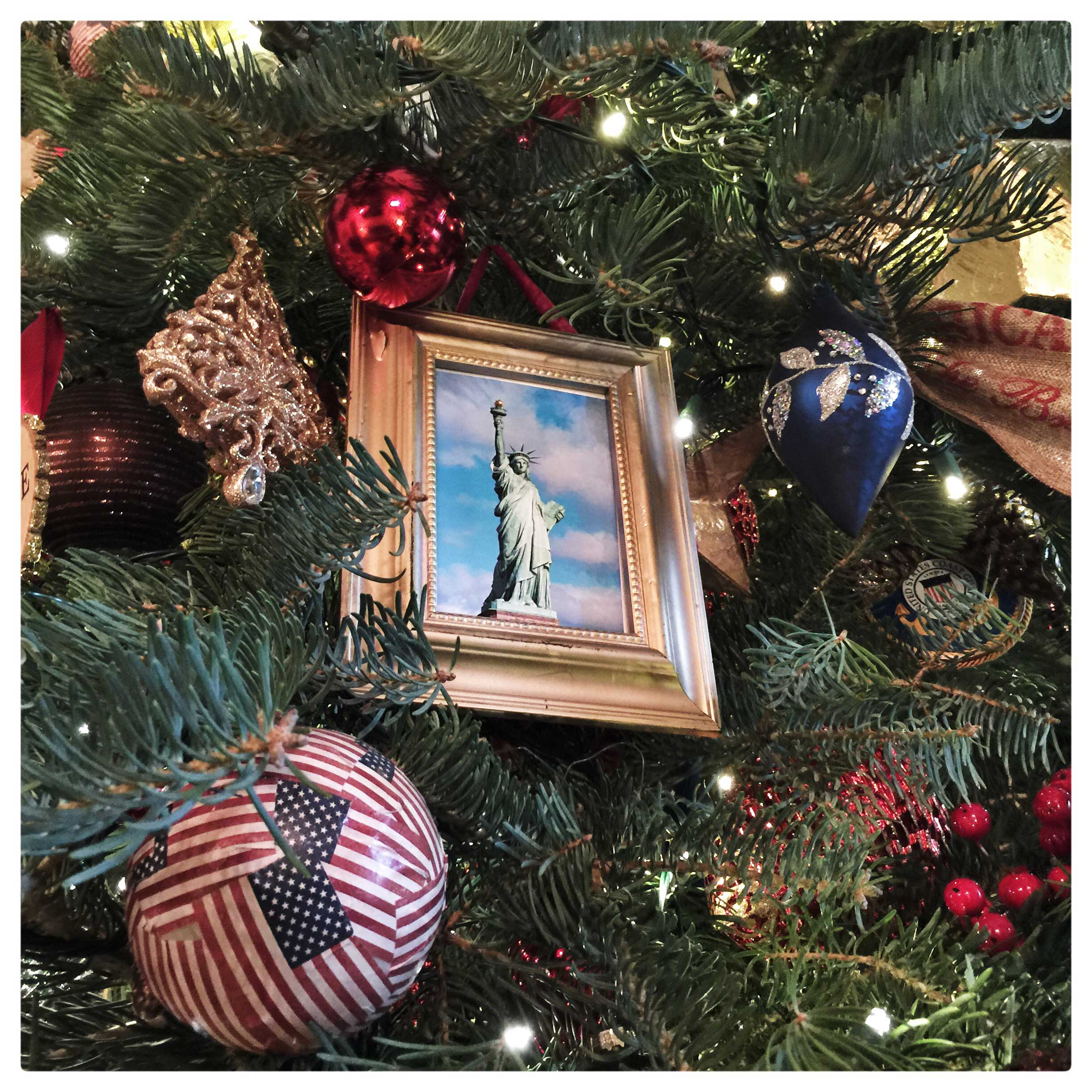 The official White House Christmas tree in the Blue Room at the White House. The 18 foot tree has over 2000 ornaments.