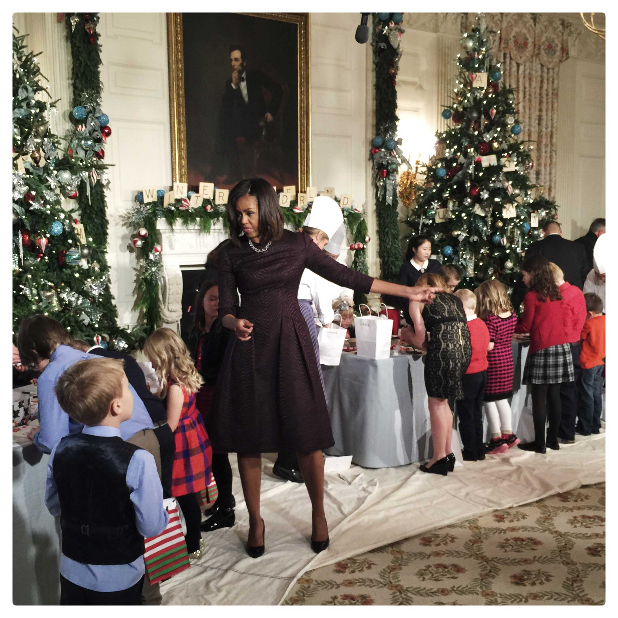U.S. first lady Michelle Obama decorates holiday crafts with military children at the State Dining Room of the White House. The first lady hosted military families to preview the holiday decorations,  which are themed                                'A Children's Winter Wonderland' this year.