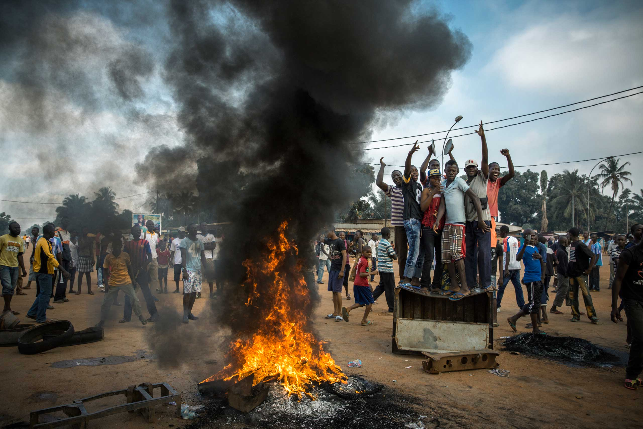 Demonstrators gather on a street to call for the resignation of interim president Michel Djotodia, who led Séléka into the capital months earlier, following the murder of a judge by members of the rebel coalition. A half hour after this picture was made, Séléka members shot into the crowd, killing two and wounding another. Bangui, Central African Republic. Nov. 17, 2013.