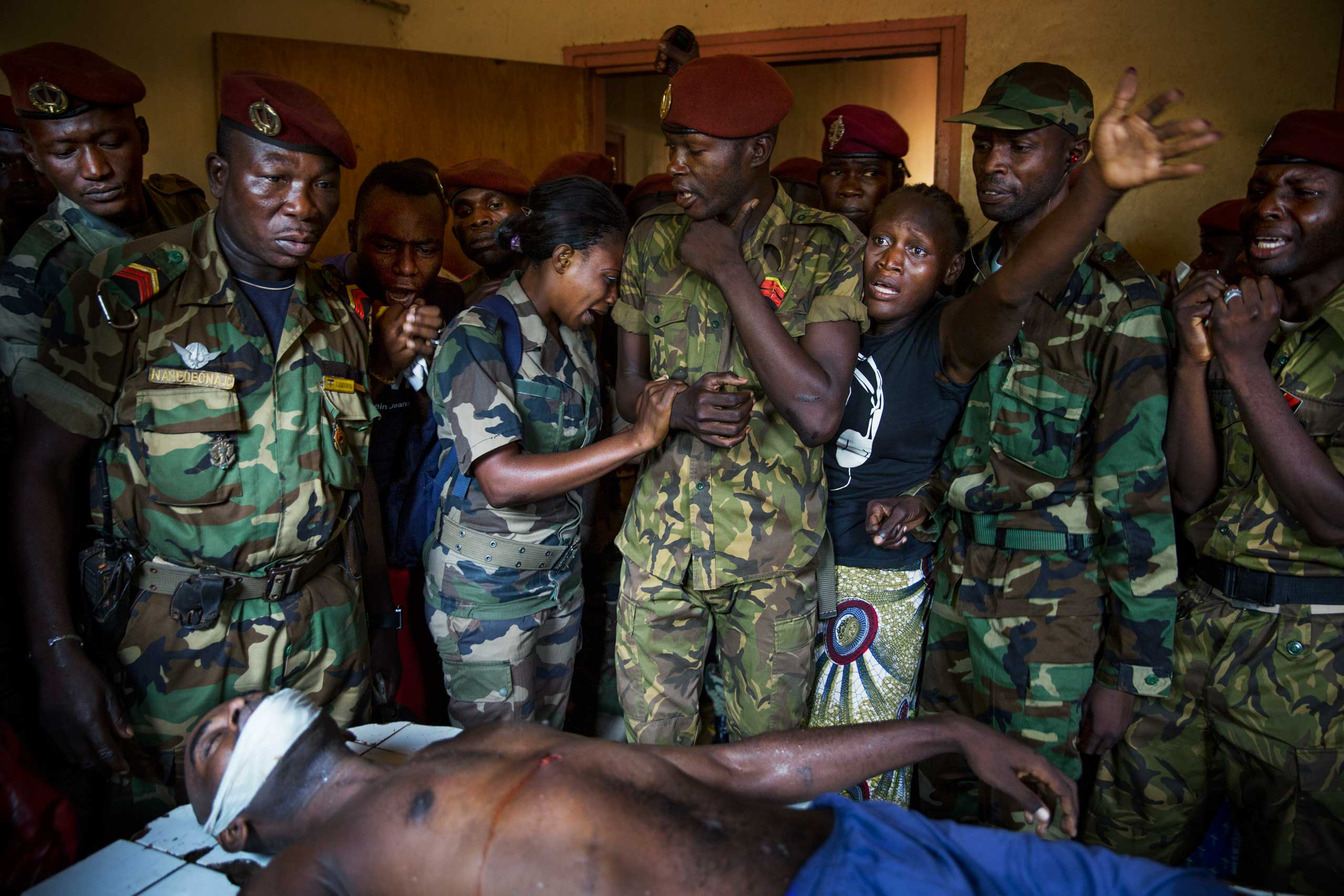 National army soldiers mourn the death of a colleague, who was killed by members of Séléka. Bangui, Central African Republic. Nov. 16, 2013.                               Correction: The original version of this caption misstated the year the photograph was taken.