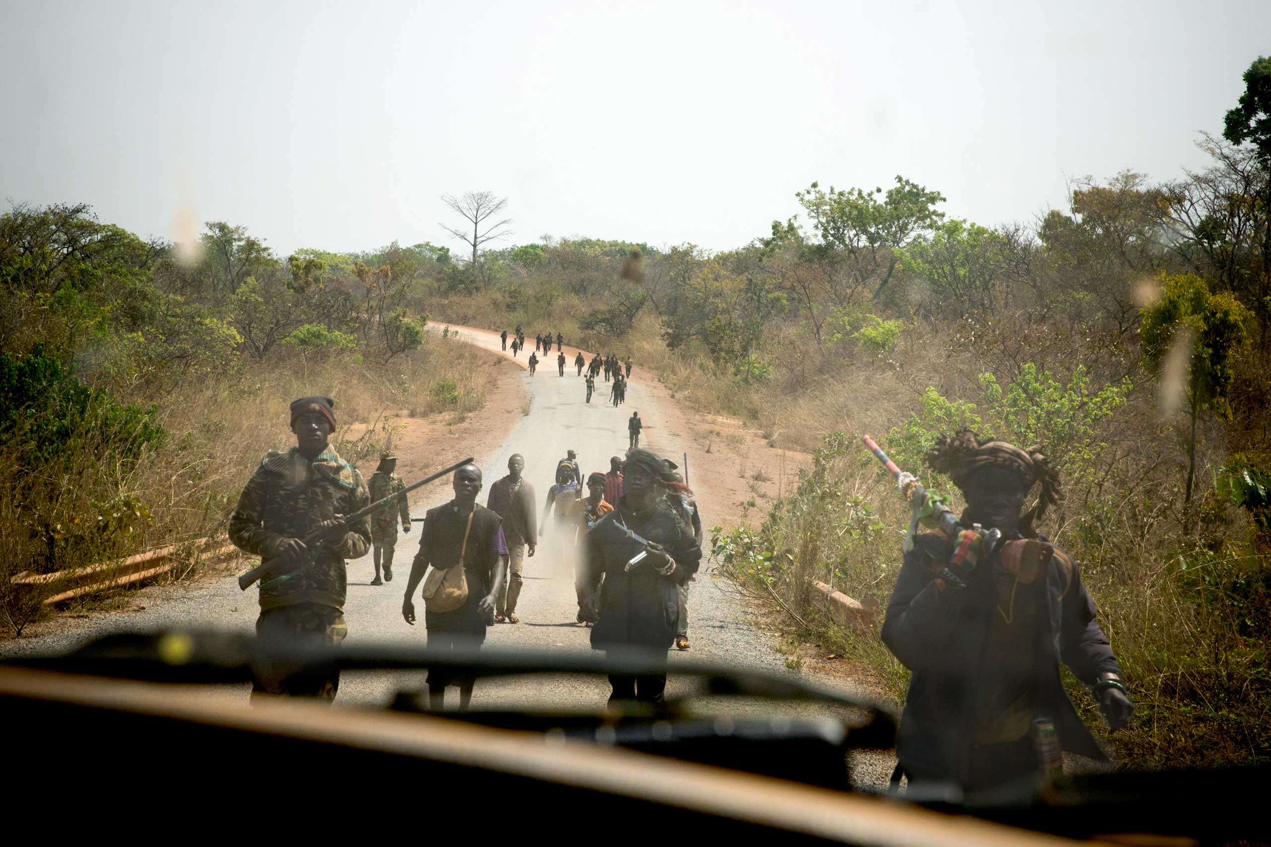 Between Bossembelé and Zawa                               Part of a group of several hundred of Anti-Balaka militias return from an attack on a Peul (Fulani - a Muslim tribe) village. Jan. 30, 2014.