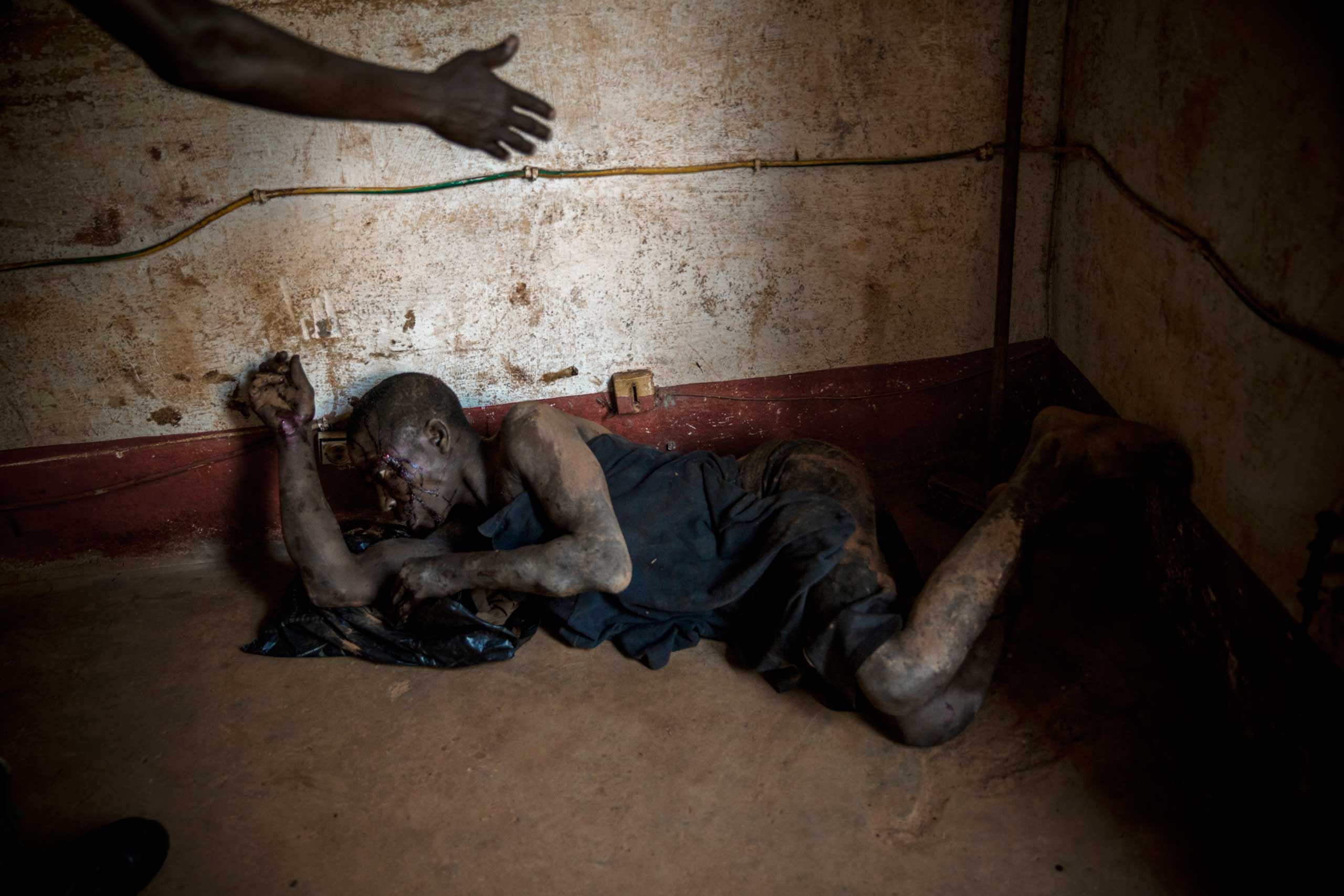 A man accused of robbery is detained at the police station and was about to be killed. Bangui,  Central African Republic. April 18, 2014.