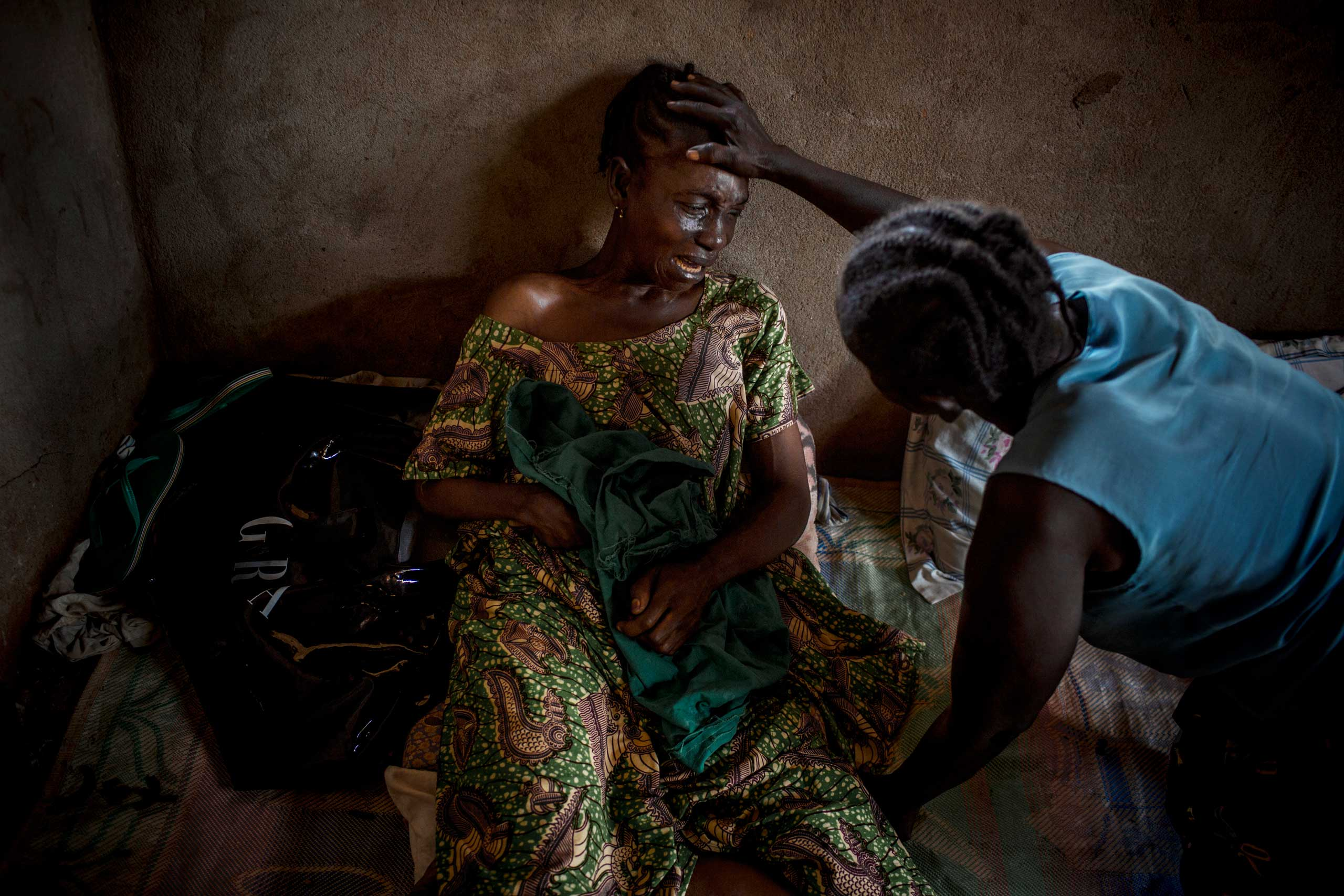 A woman cries after the death of her 23-year-old daughter, who  was said to be killed by a grenade launched in her courtyard by a member of Séléka. Bangui, Central African Republic. Nov. 14, 2013.