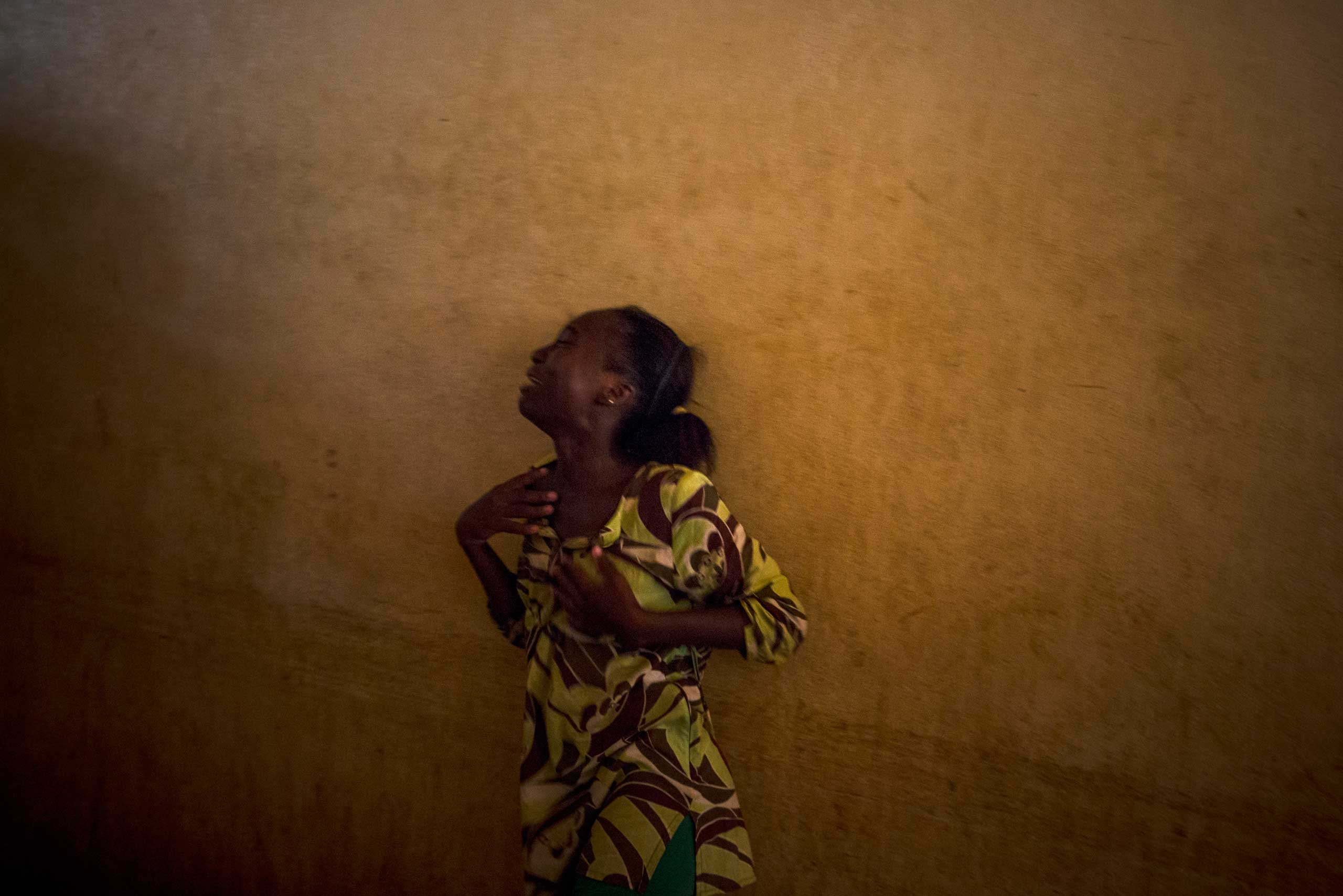 A relative cries over the death of a soldier shot to death by Séléka the night before. Bangui, Central African Republic. Nov. 16, 2013.