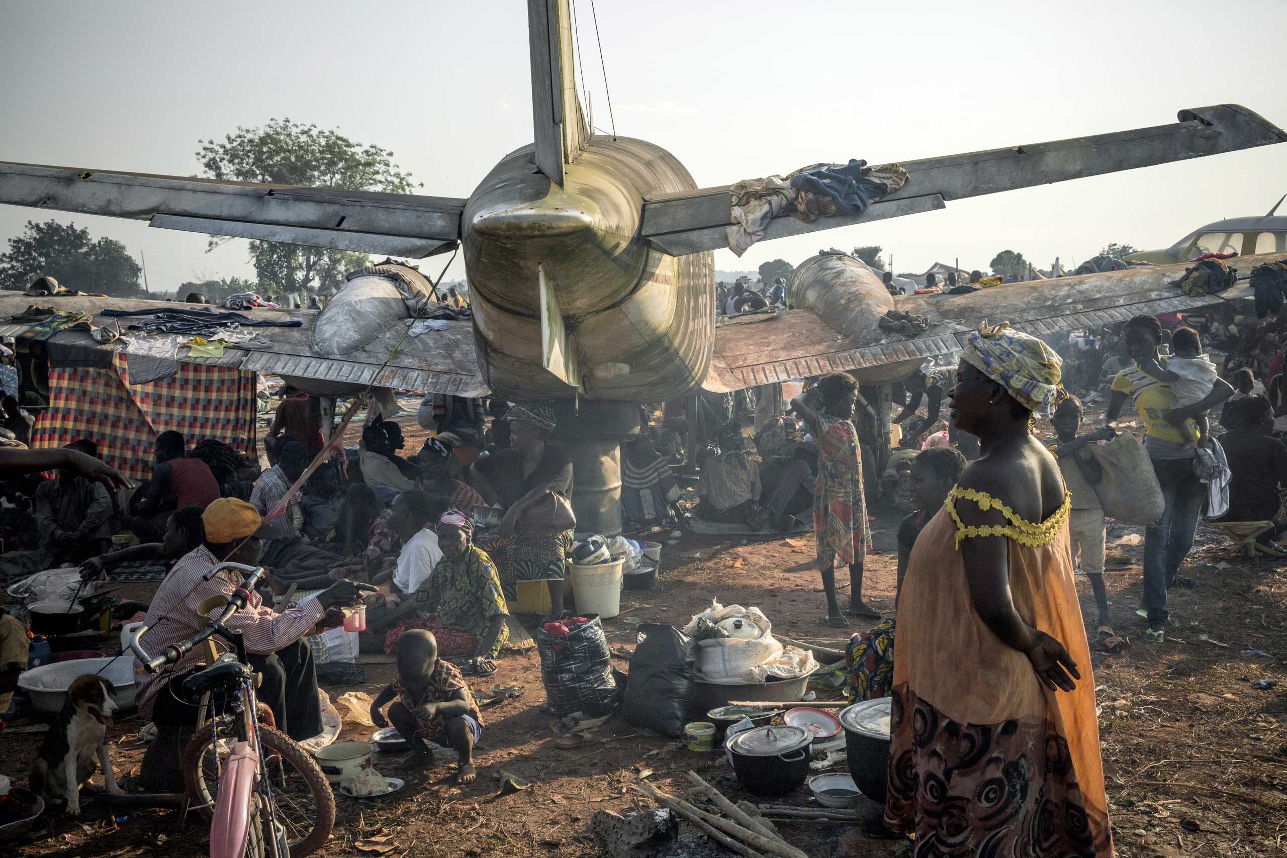 A makeshift camp near Bangui's main airport would grow to hold more than 100,000 people at its peak in late 2013 and early 2014. They had fled fighting between Séléka and anti-balaka, and felt more secure with French forces at the entrance. Bangui, Central African Republic. Dec. 8, 2013.