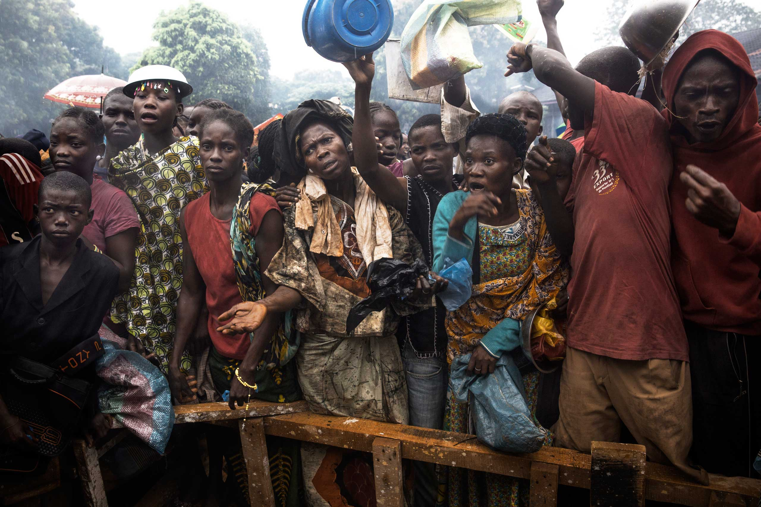 Internally displaced persons wait in line for food. Bangui, Central African Republic. Dec. 9, 2013.
