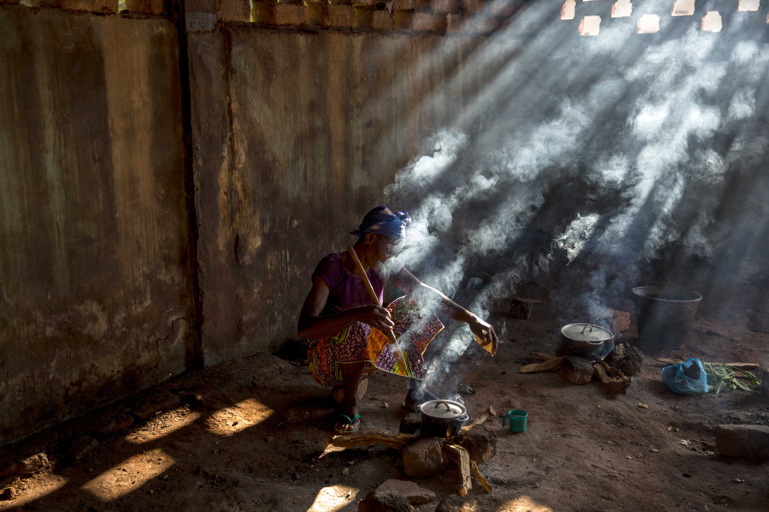 A woman cooks in the hospital coumpound. Bambari, Central African Republic. Sept. 24, 2014.