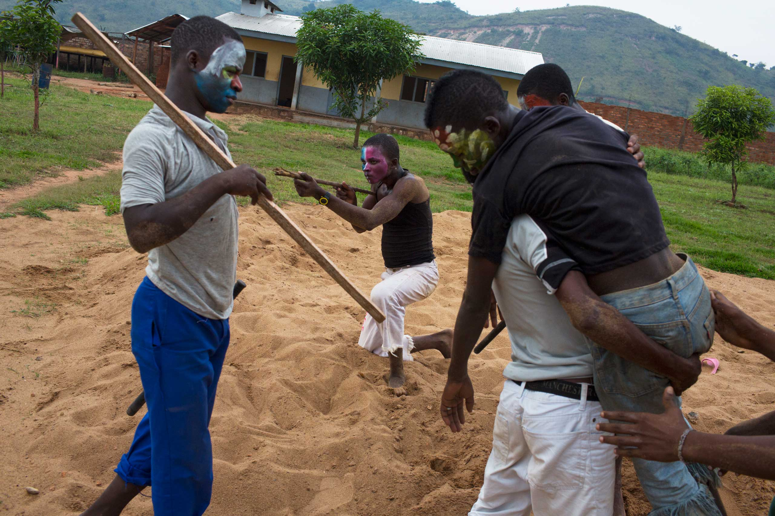 Former child soldiers play war games as part of their rehabilitation work. The UNICEF psychologist looking after them said such activities help them to deal with their past. Central African Republic. Dec. 3, 2013.                               Correction: The original version of this caption misstated the year the photograph was taken.