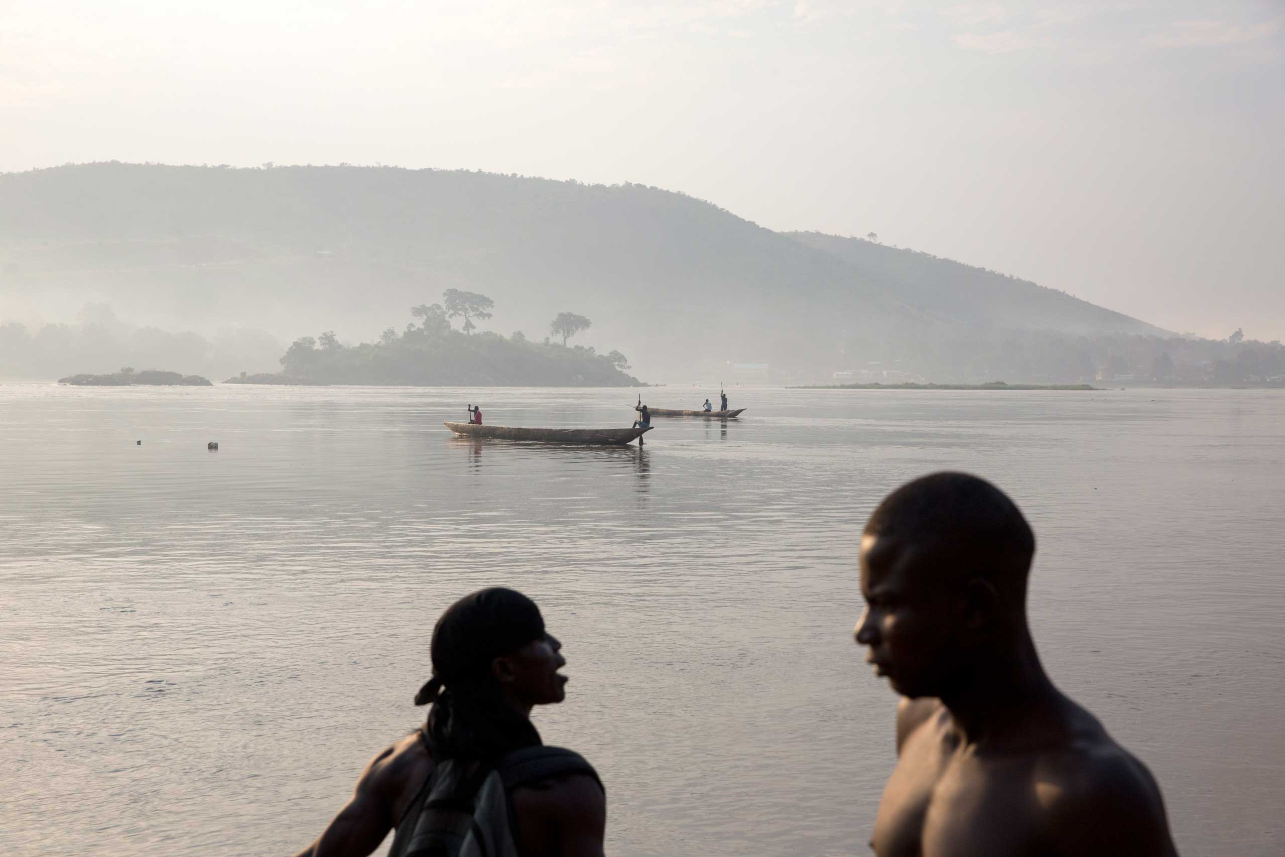 Fishermen on the Oubangui river early in the morning. Hundreds were killed in the capital a year earlier. Bangui, Central African Republic. Dec. 5, 2014.                               Correction: The original version of this caption misstated when hundreds of people were killed in Bangui. It was in 2013.