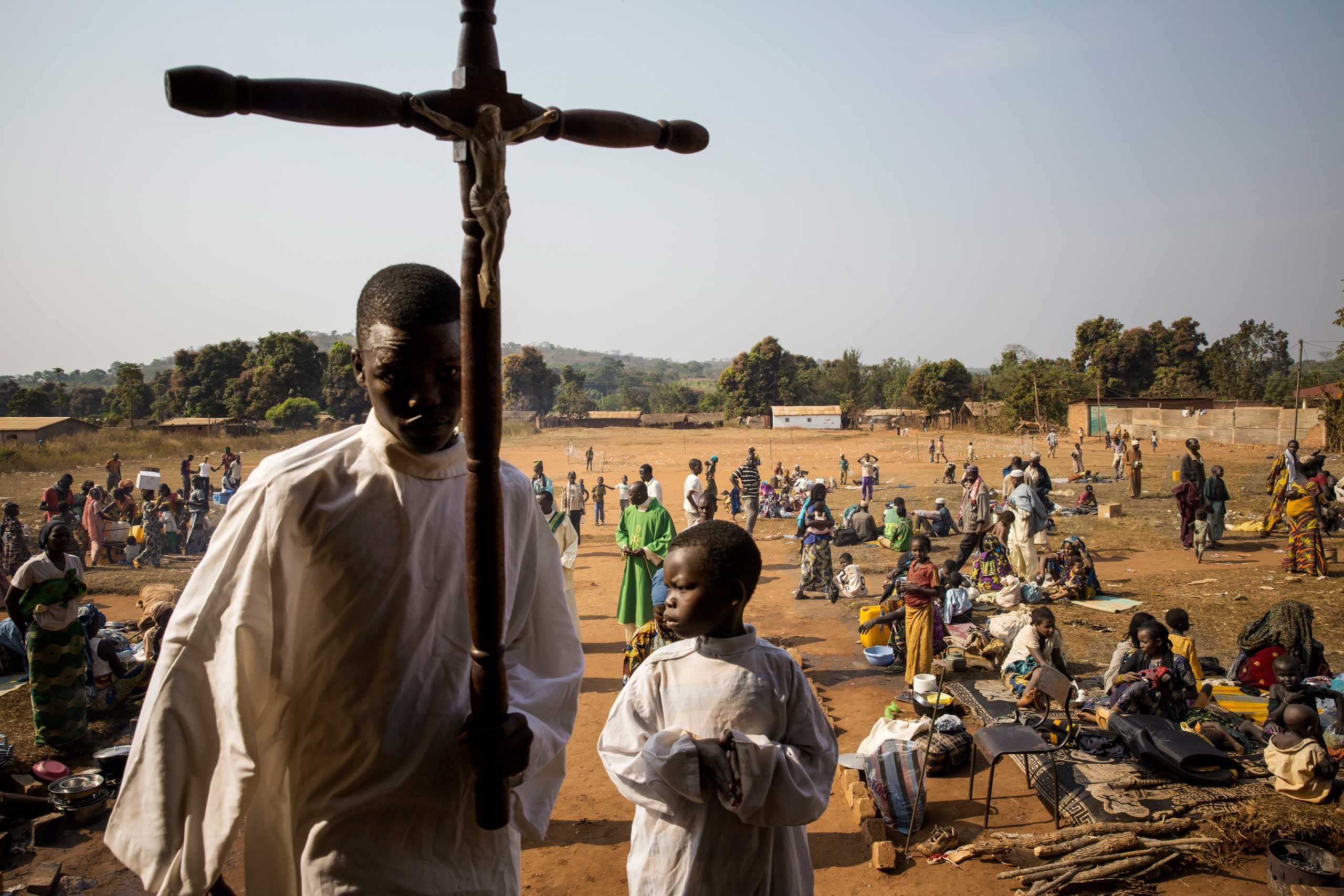 An alter boy prepares for mass at a church where the priest offered refuge to a large group of Muslims who were being targeted by anti-balaka. Boali,  Central African Republic. Jan. 26, 2014.