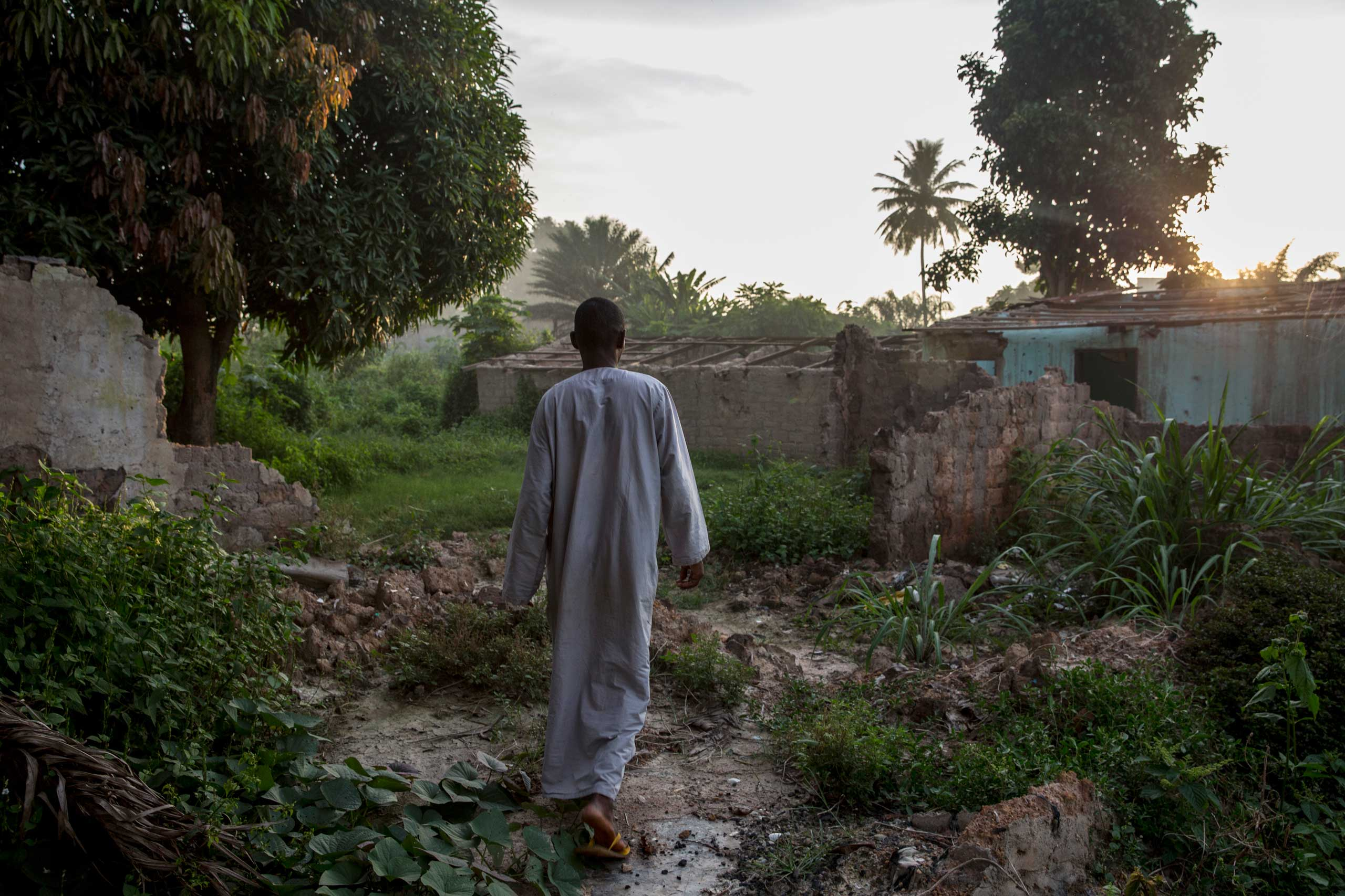 Malouloud Mahamat Amat, 30, walks in his former compound in the 5Kilo area. He lost 8 members of his family in March. He is the only one of the family who stayed in the capital. Bangui, Central African Republic. Sept, 20, 2014.
