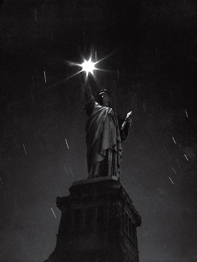The Statue of Liberty, photographed during a blackout in 1942 - an eloquent expression of the nation's mood in the first full year of a global conflict with no real end in sight.