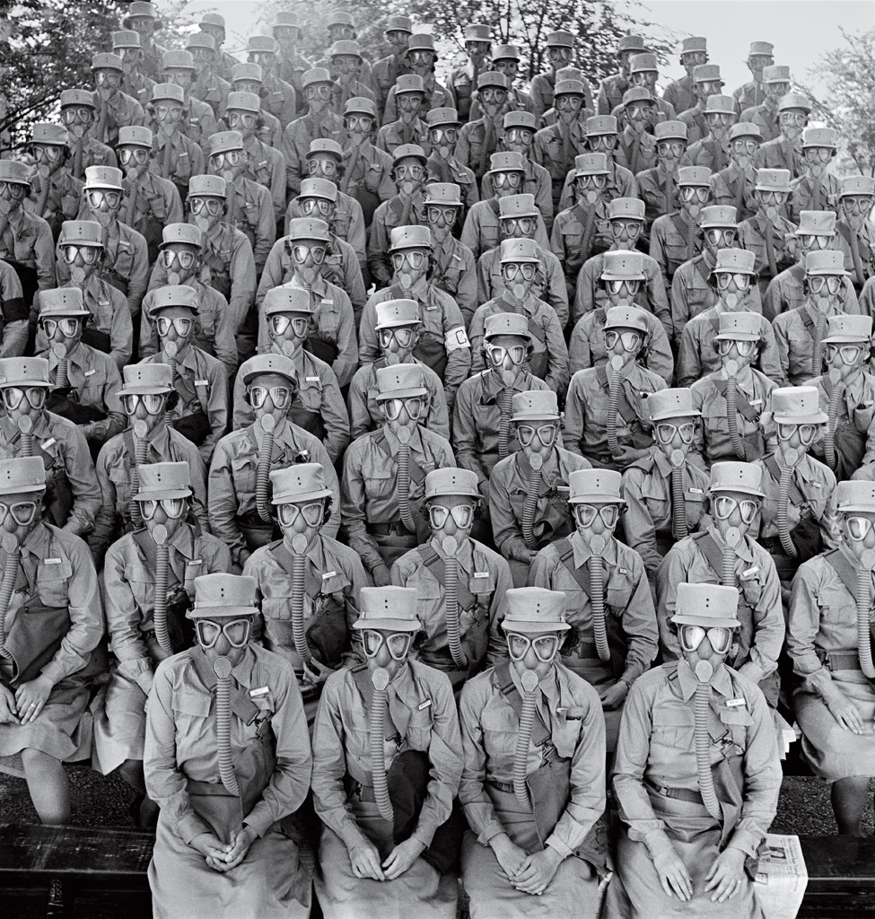"Members of the Women's Auxiliary Army Corps, commonly known as WAACs, don their first gas masks at Fort Des Moines, Iowa, in June 1942. The female troops were famously praised by General Douglas MacArthur, who called them ""my best soldiers."""