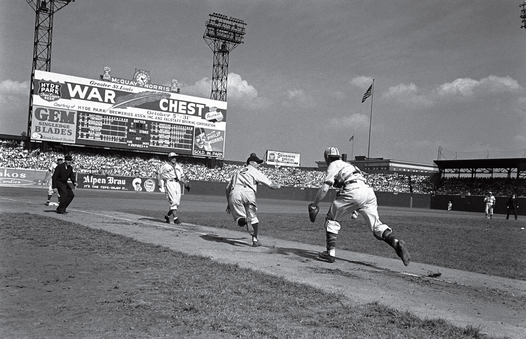 The home front: At Sportsman's Park in St. Louis, a visiting New York Giant is caught in a rundown in the summer of 1943. At a time when seemingly everything in America - race relations, gender roles, the country's very idea of itself - was undergoing profound change, the national pastime offered an antidote to anxiety and dread. Namely, something familiar. Something unchanging.