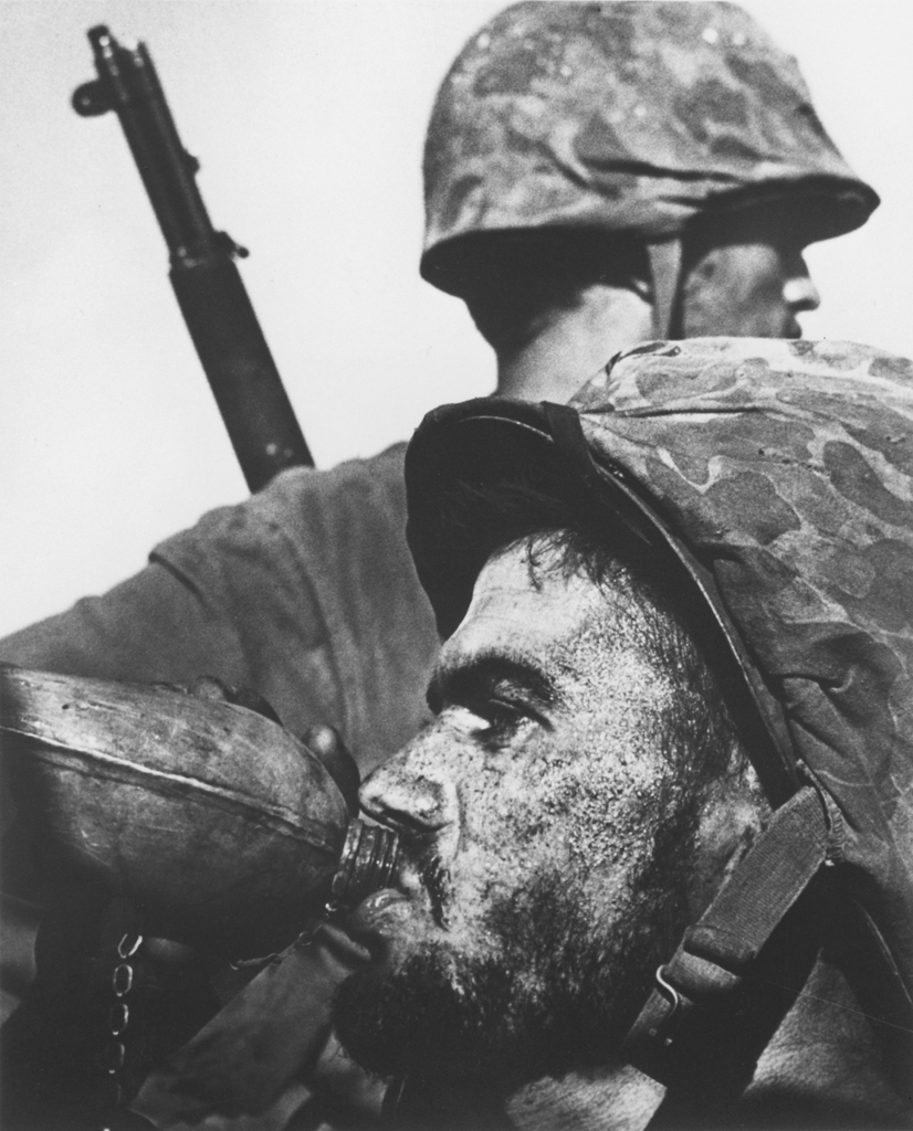 "Photographer W. Eugene Smith's picture of a Marine drinking from his canteen during 1944's Battle of Saipan is as iconic a war picture as any ever made. In fact, when the U.S. Postal Service released a ""Masters of American Photography"" series of commemorative stamps in 2002, Smith was included - and this image was chosen as representative of his body of work."