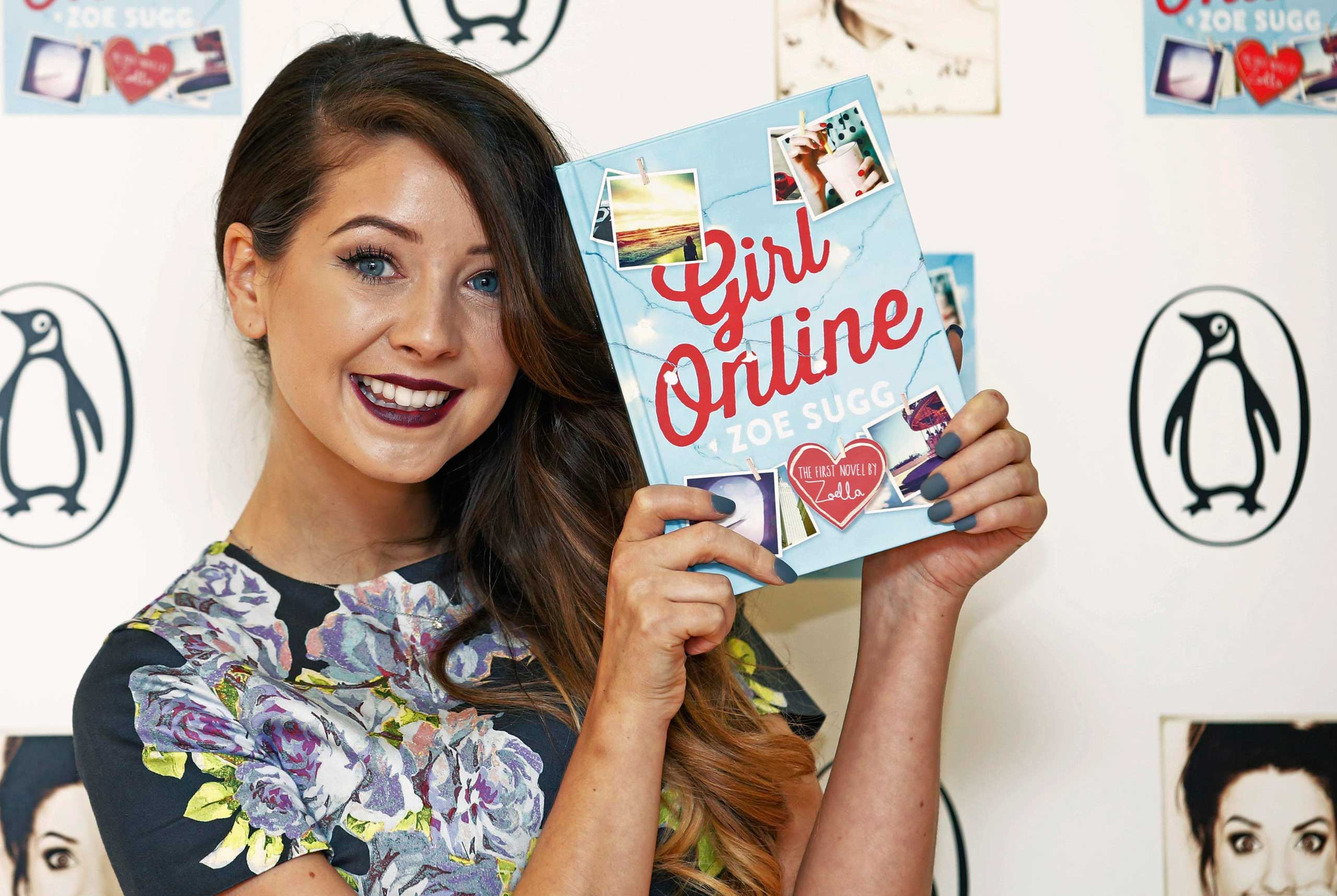 YouTube blogger Zoe Sugg, known as Zoella, poses during a photocall for her debut novel  Girl Online  in London, Nov. 24, 2014.