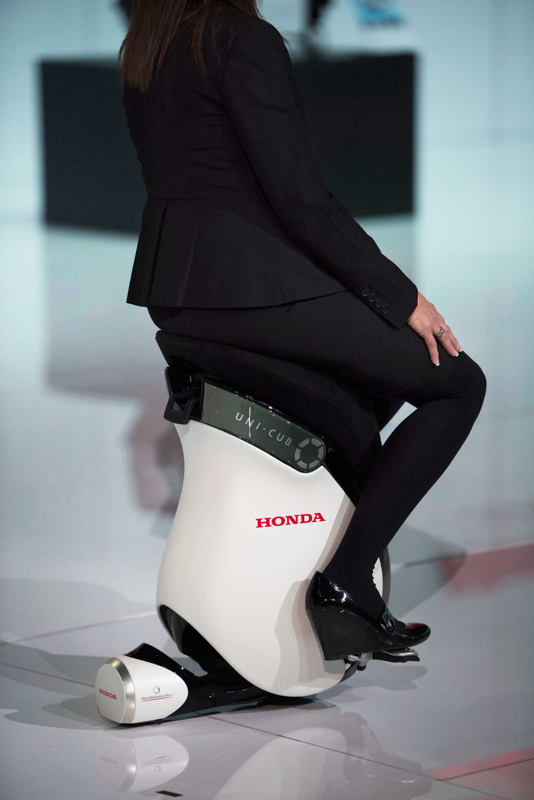 The Honda Motor Co. UNI-CUB B personal mobility device is demonstrated on Jan. 13, 2015 in Detroit.
