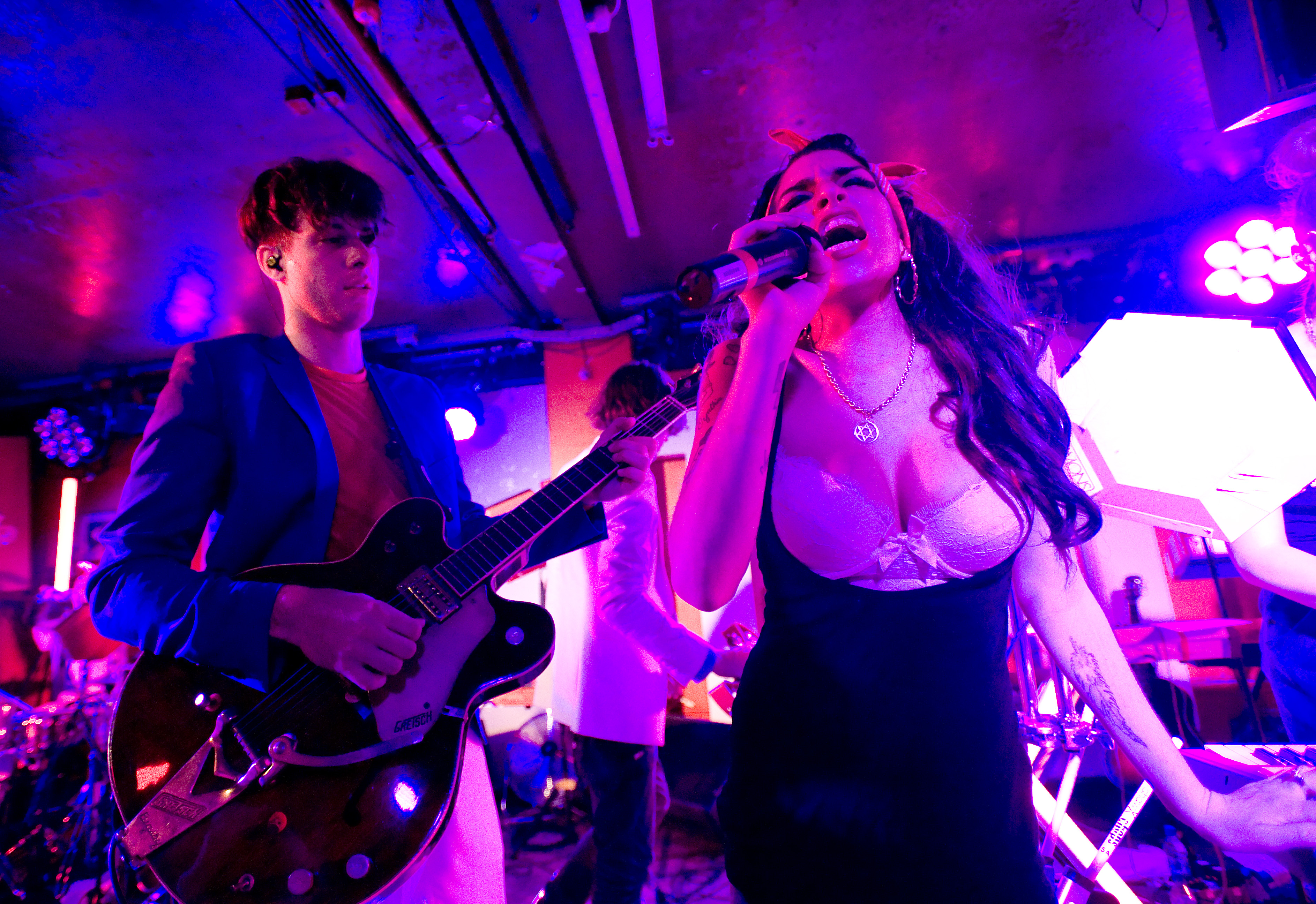 Amy Winehouse makes a surprise appearance as she performs with Mark Ronson (L) at the 100 Club on July 6, 2010 in London, England.