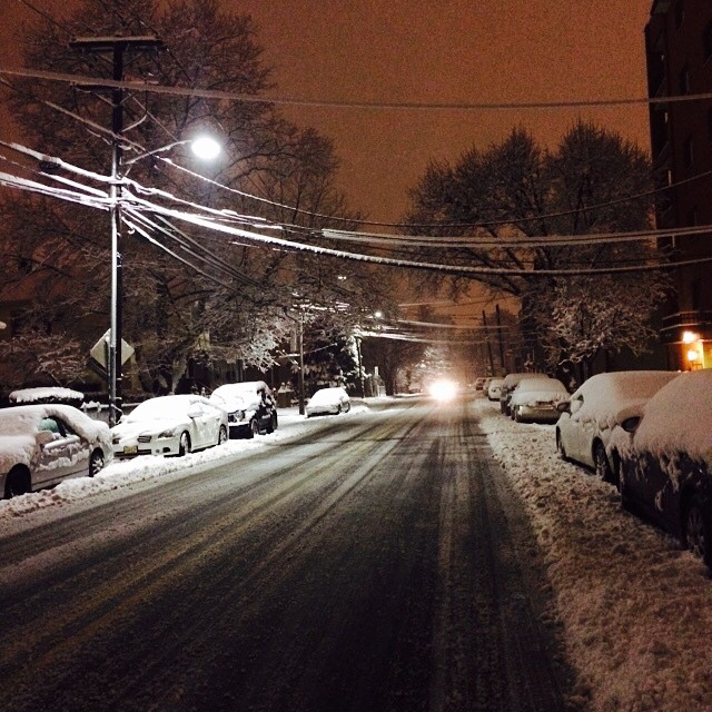 """LaTanya Brown posted this photo of a snowy street in Cliffside Park, NJ to Instagram this morning, saying """"Wish I owned a plow... ❄️🙇💭 💰💰 #now #early #exploring #sunrise #snow"""""""
