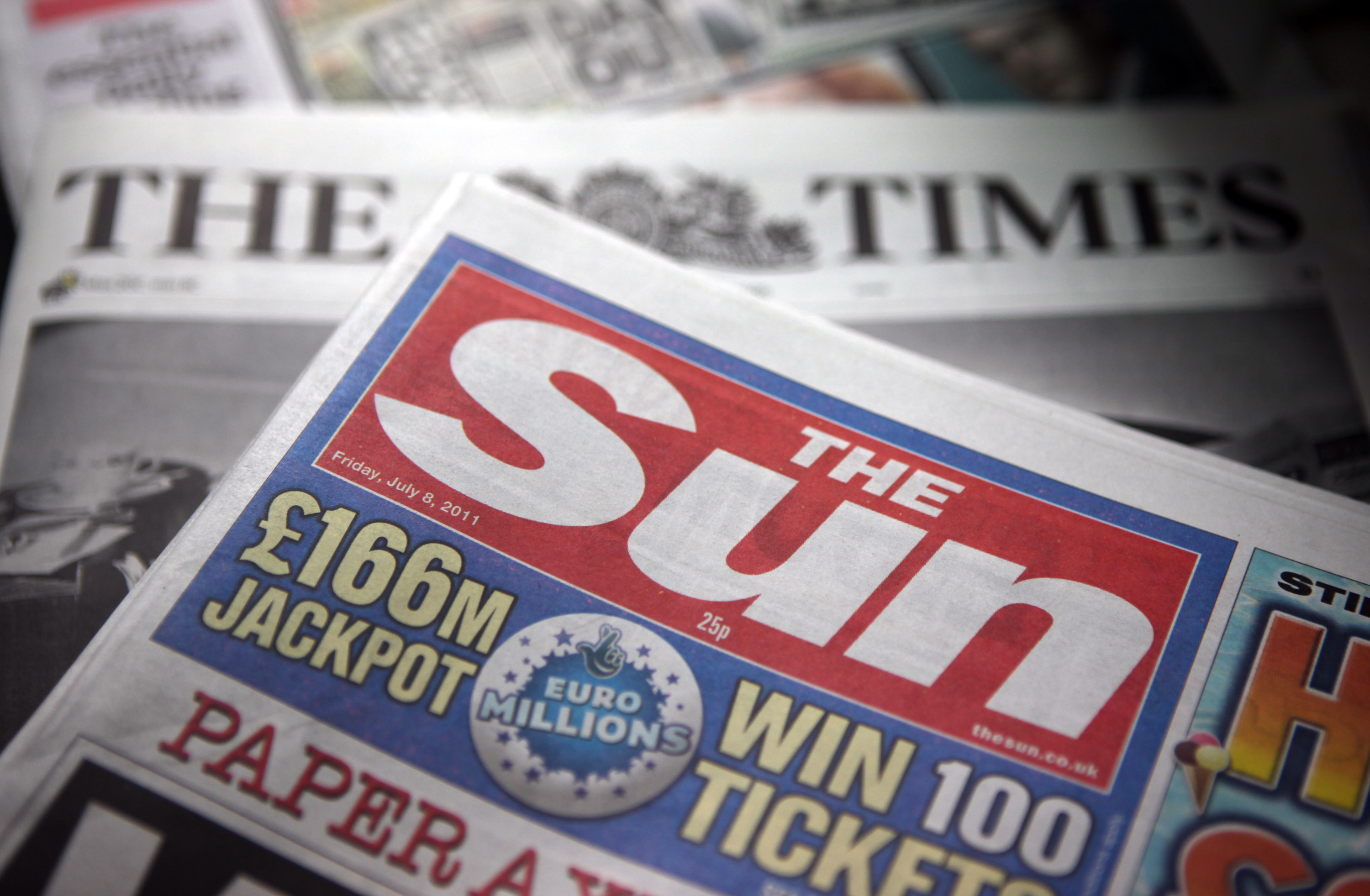 A copy of the Sun and the Times newspapers, published by News International are seen on display at a news agent in London on  July 8, 2011